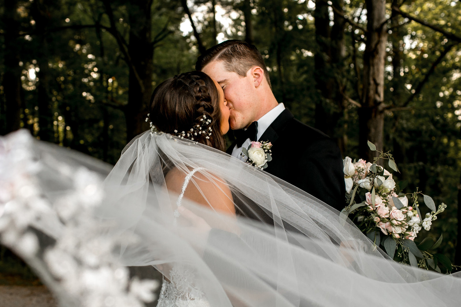 Wedding Couple in Des Moines Iowa with veil shot.