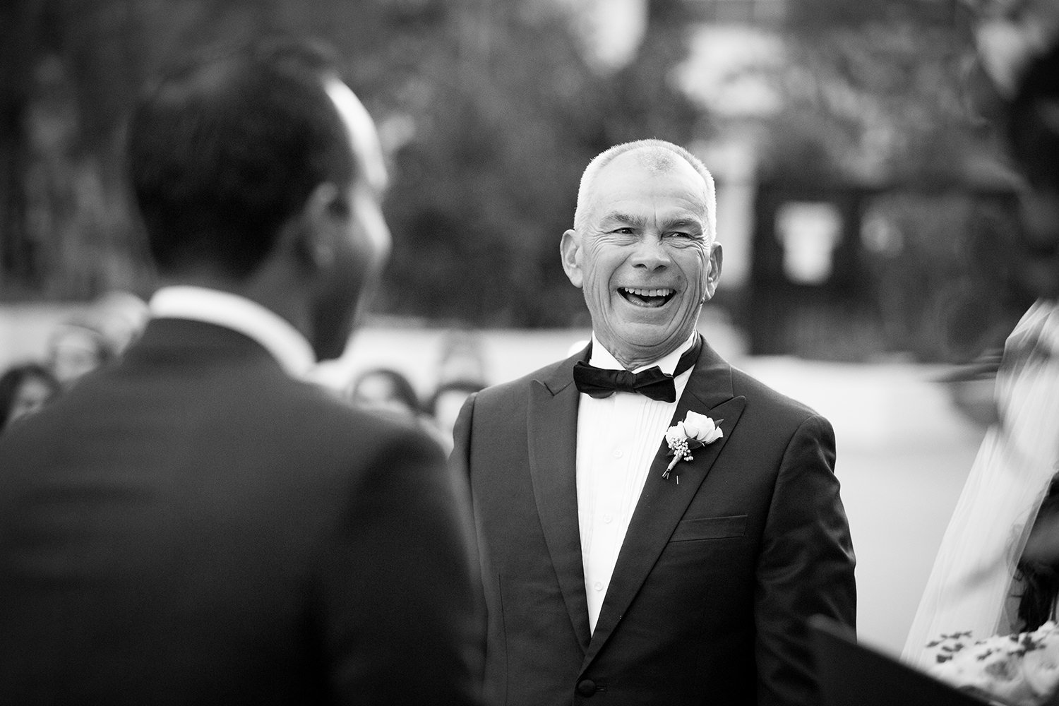 father of the bride crying and laughing