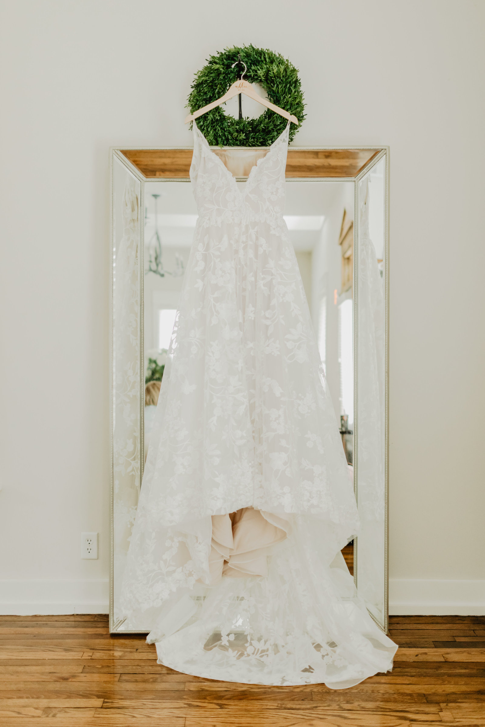 Gorgeous lace wedding dress hanging in bridal suite at Long Hollow Gardens.