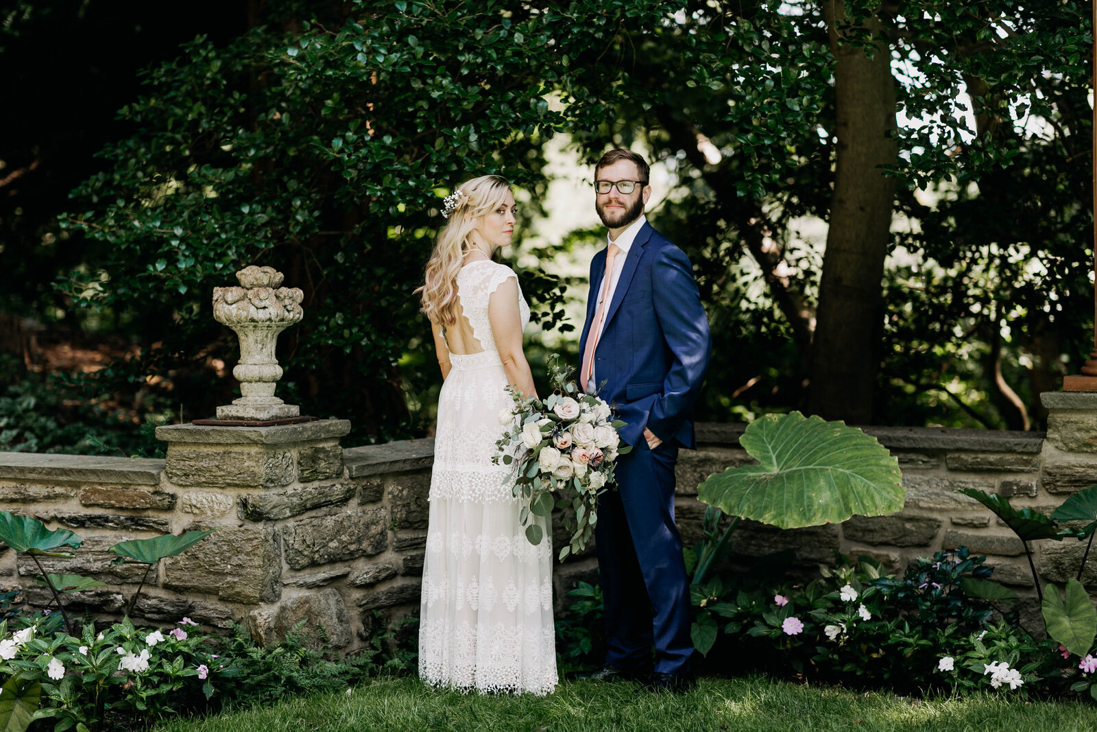 bride and groom in floral garden