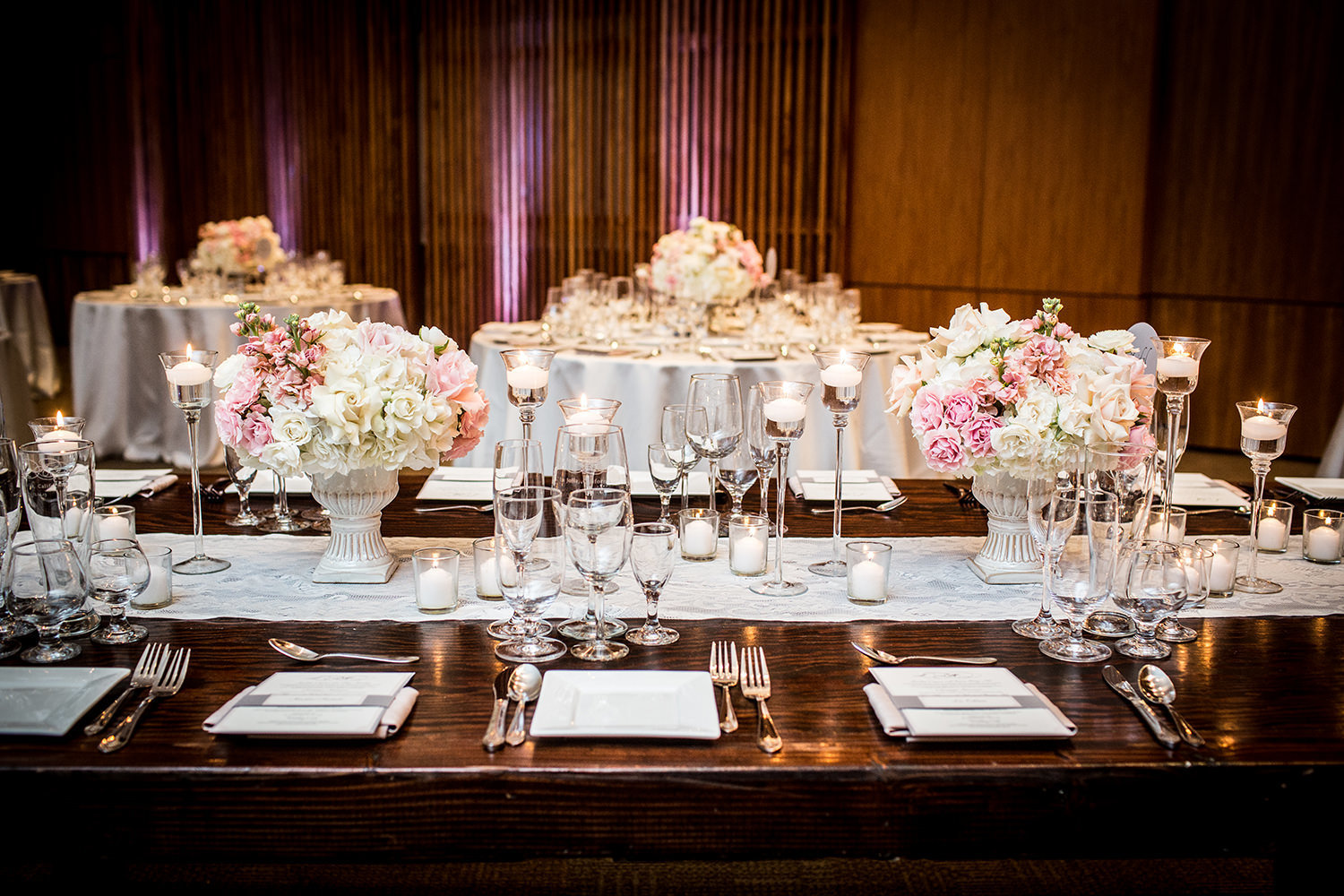 tables with pink and blush flowers