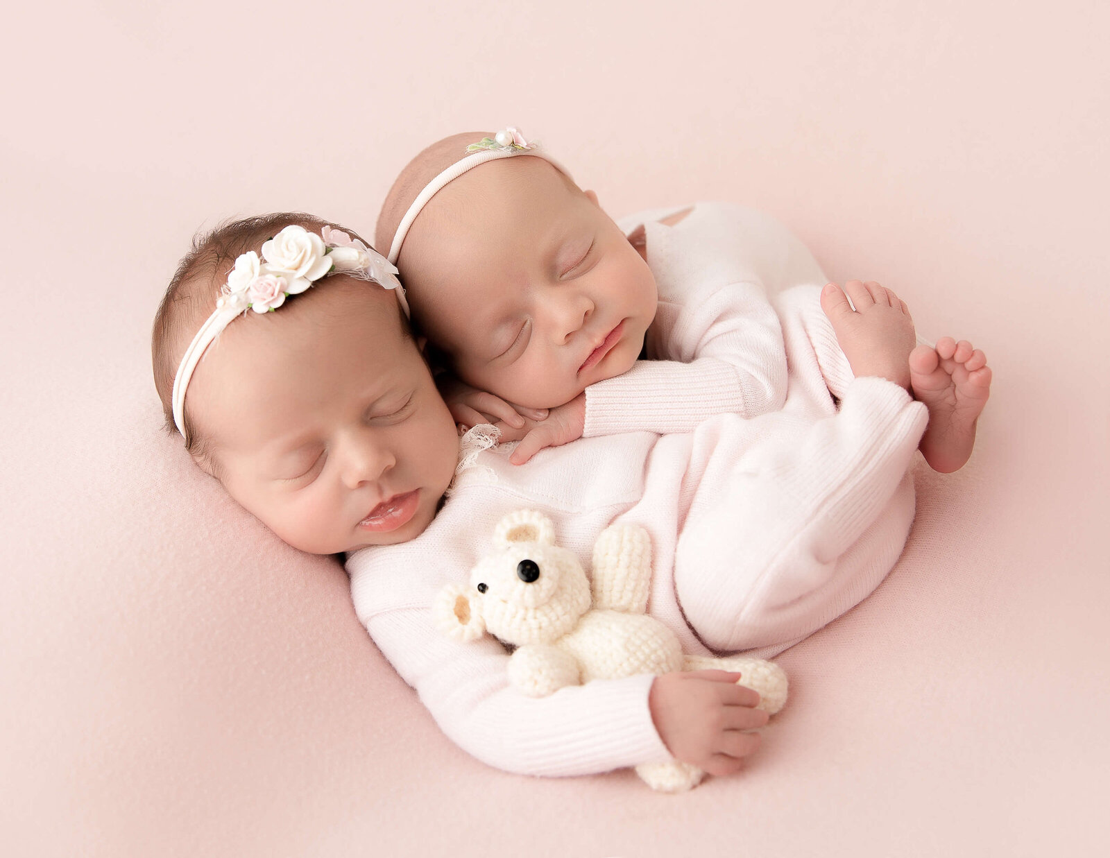 Sweet newborn  twin sisters at our in-home Rochester, NY studio.