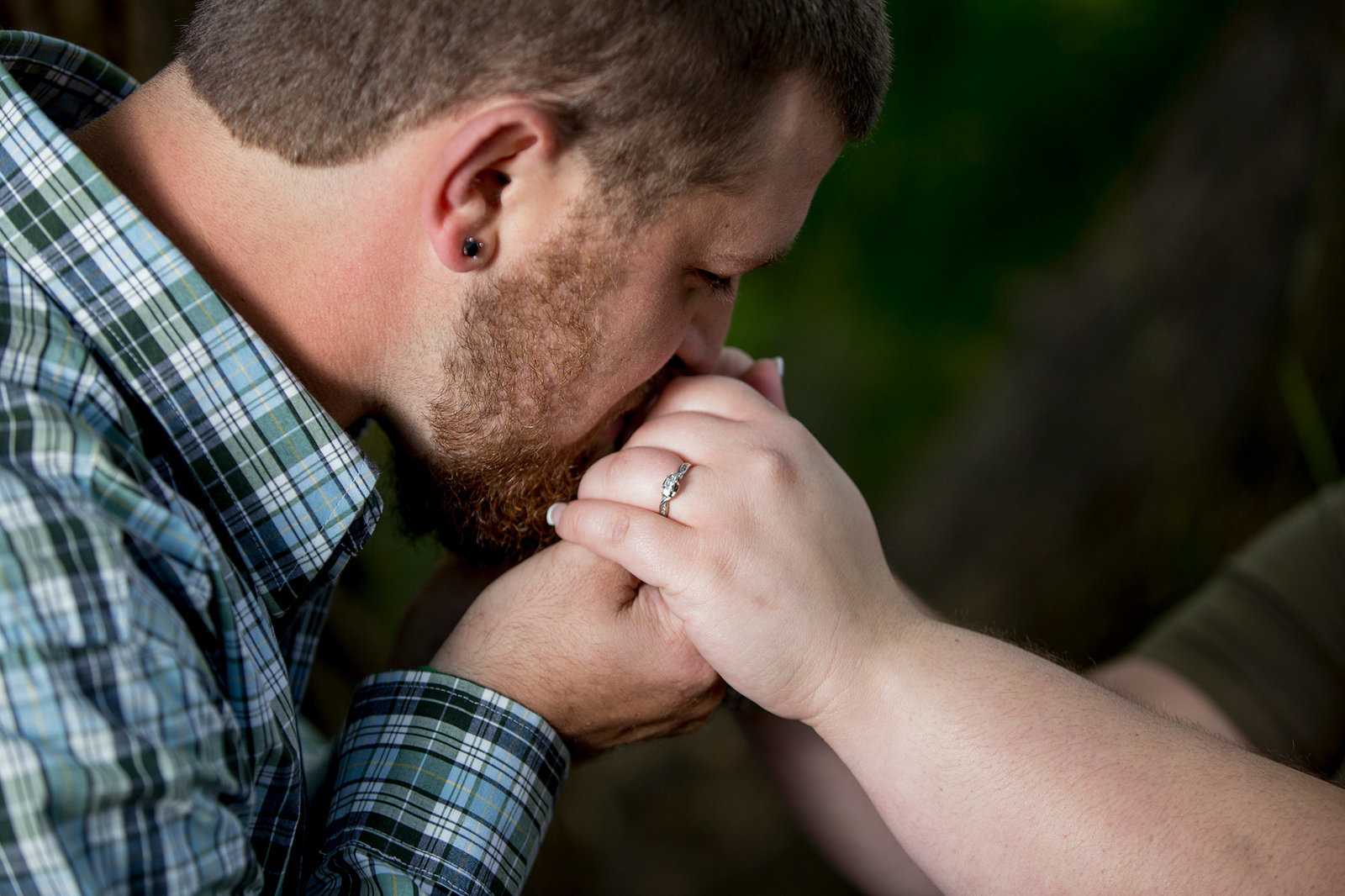 man kisses fiancee's hand in Erie, PA
