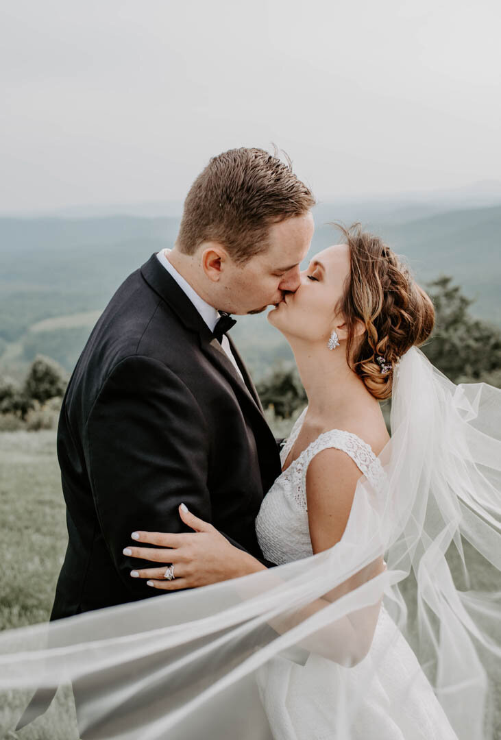 bride and groom kiss at wedding at Sky Retreat in Boone NC