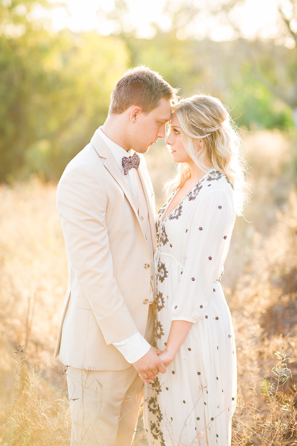 beautiful light with bride and groom open field