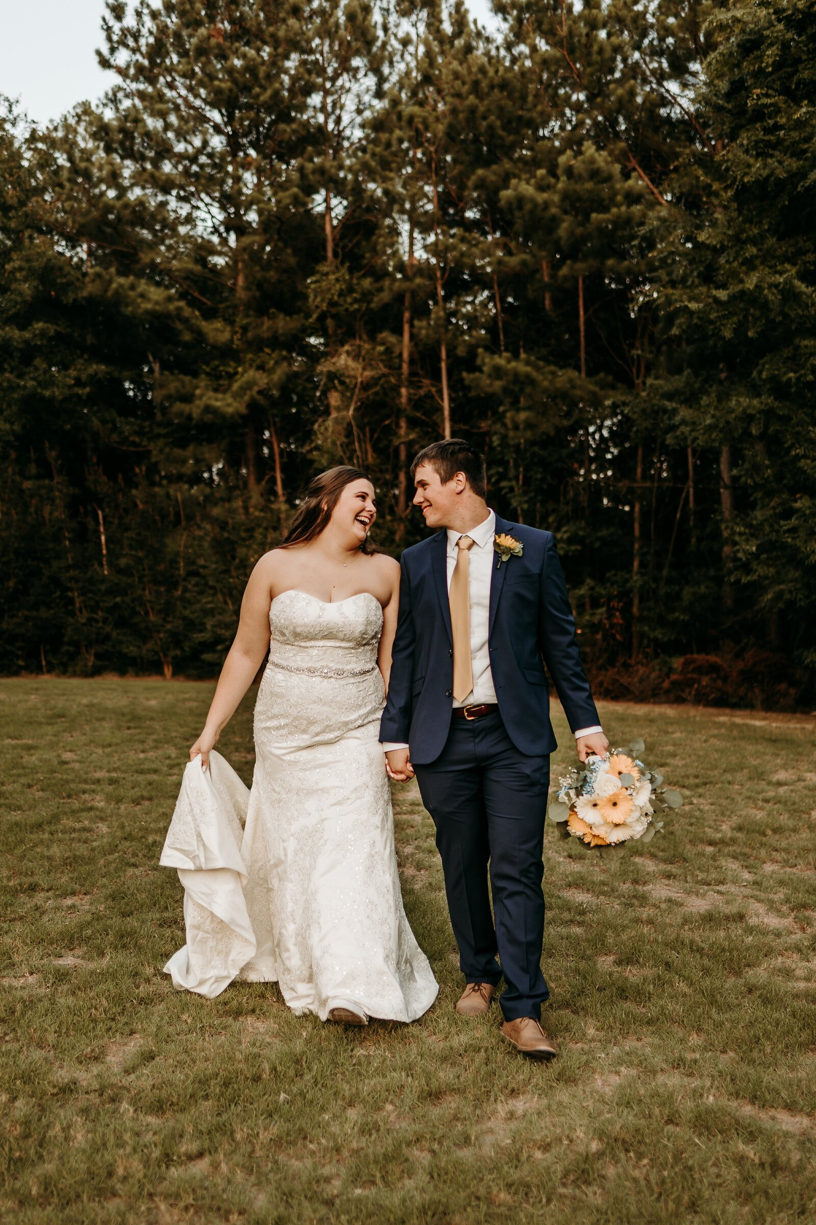 J.Michelle Photography photographs bride and groom walking portrait