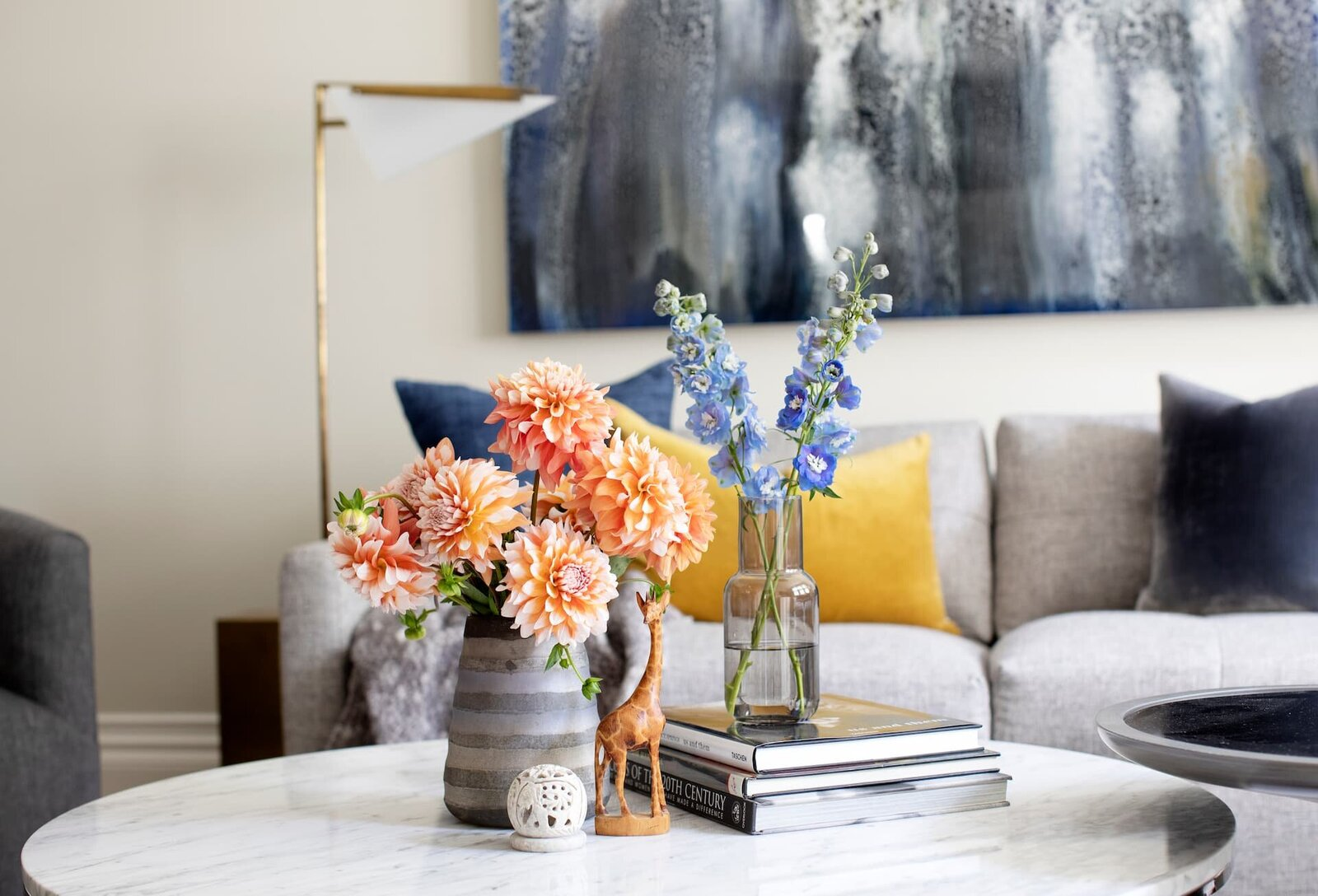 Granville Street l Living-TV Room l Detail of Coffee Table Styling with Dahlias and Delphinium on stack of Books