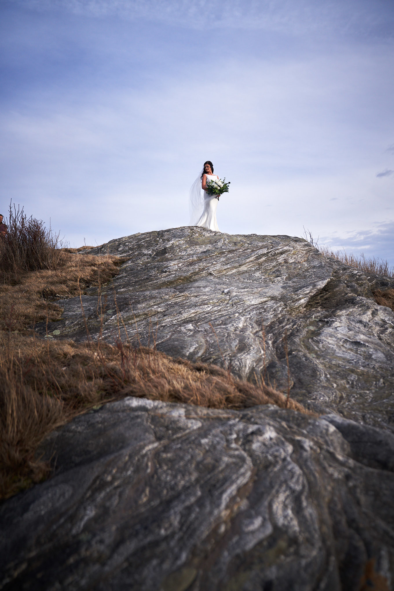 bride standing on rocks
