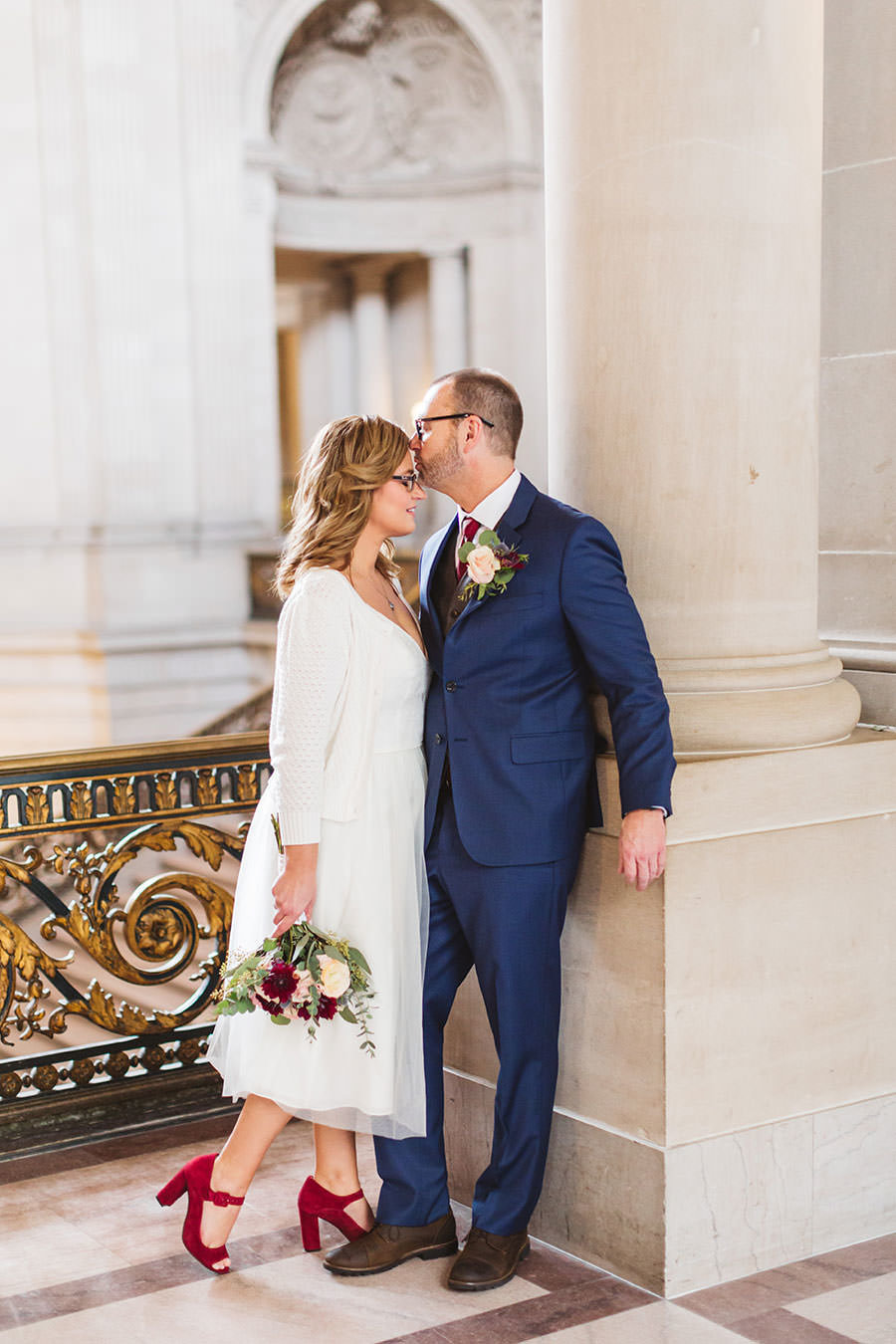 bride wears red shoes at SF city hall ceremony