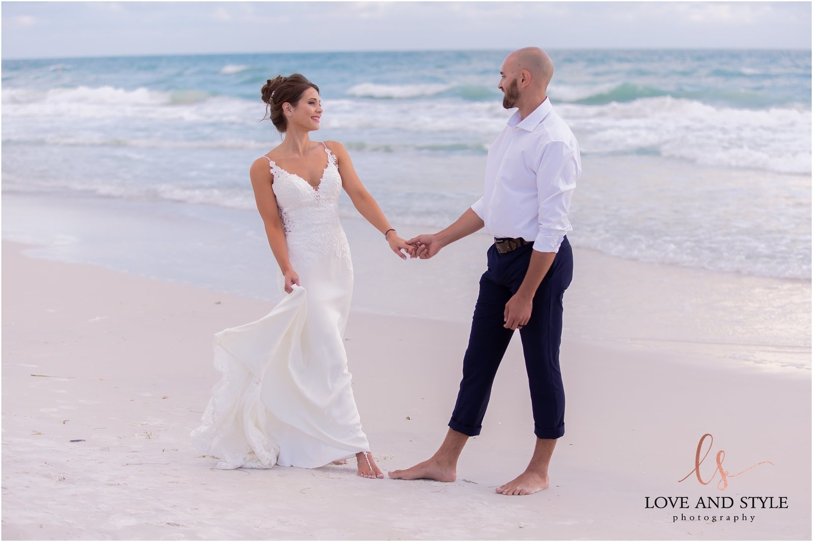 Bride and Groom walking on Bradenton Beach in front of The Beach House Restaurant