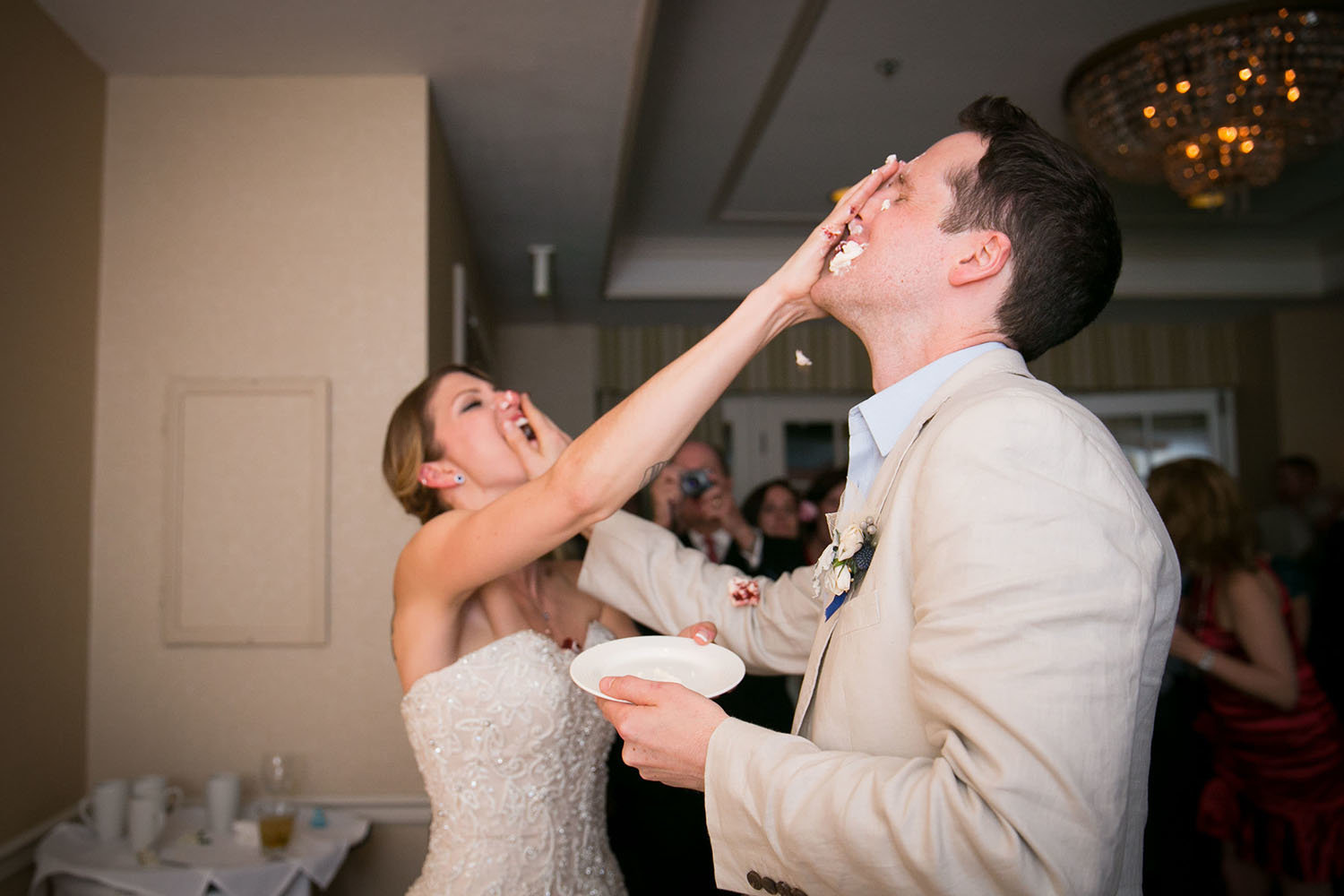 Cake smash at the wedding reception | L'Auberge Del Mar