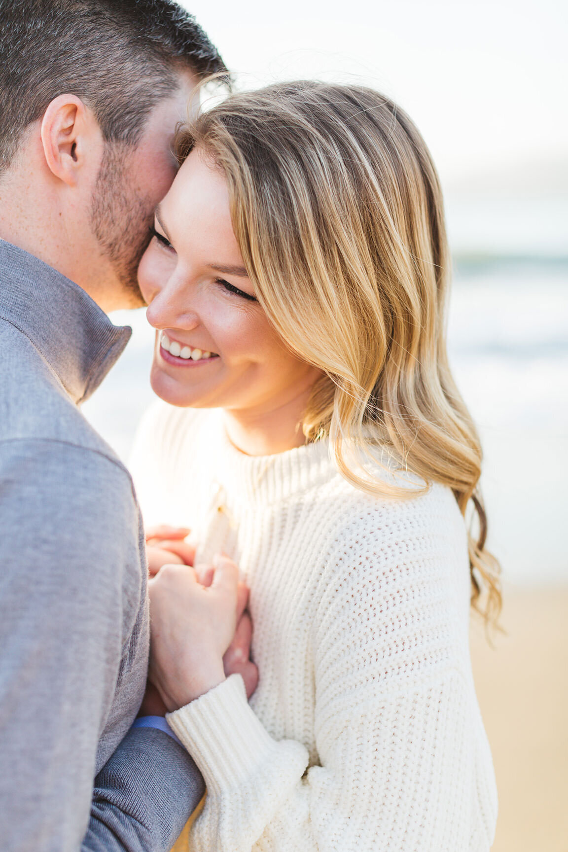 fun engagement photography on the baker beach, san francisco