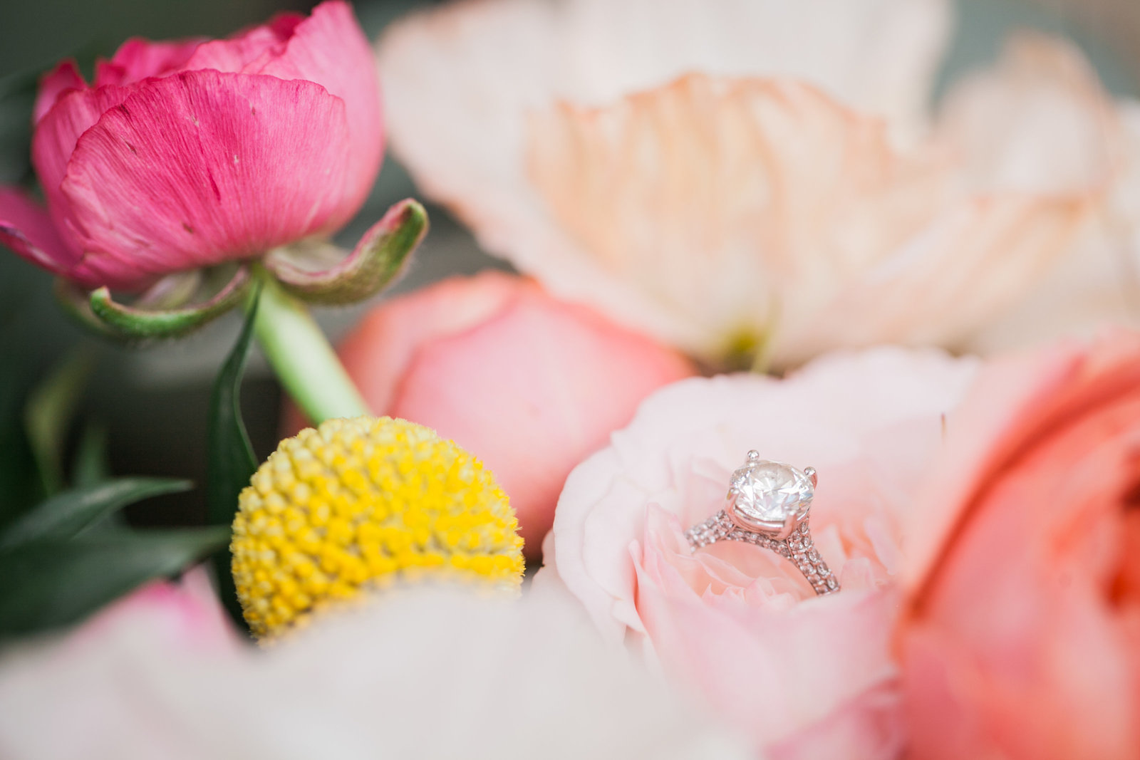 two carat engagement ring in a bridal bouquet