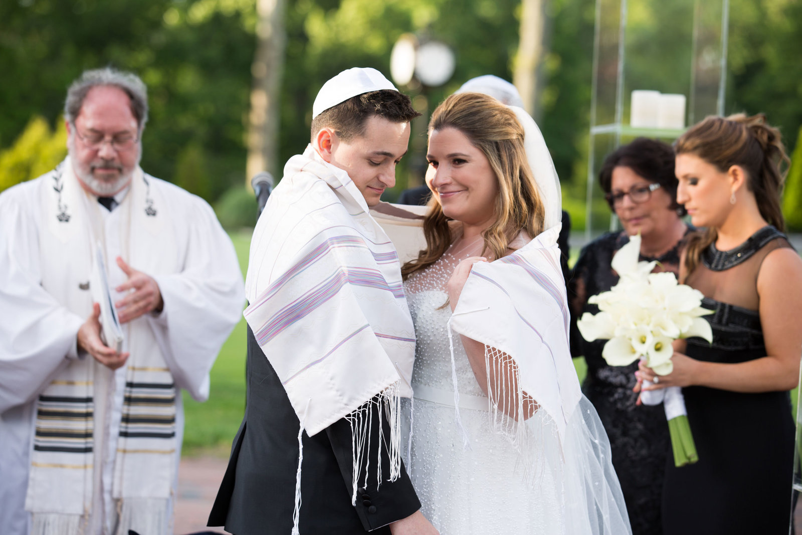 bride and groom during Jewish ceremony at Engineers Country Club