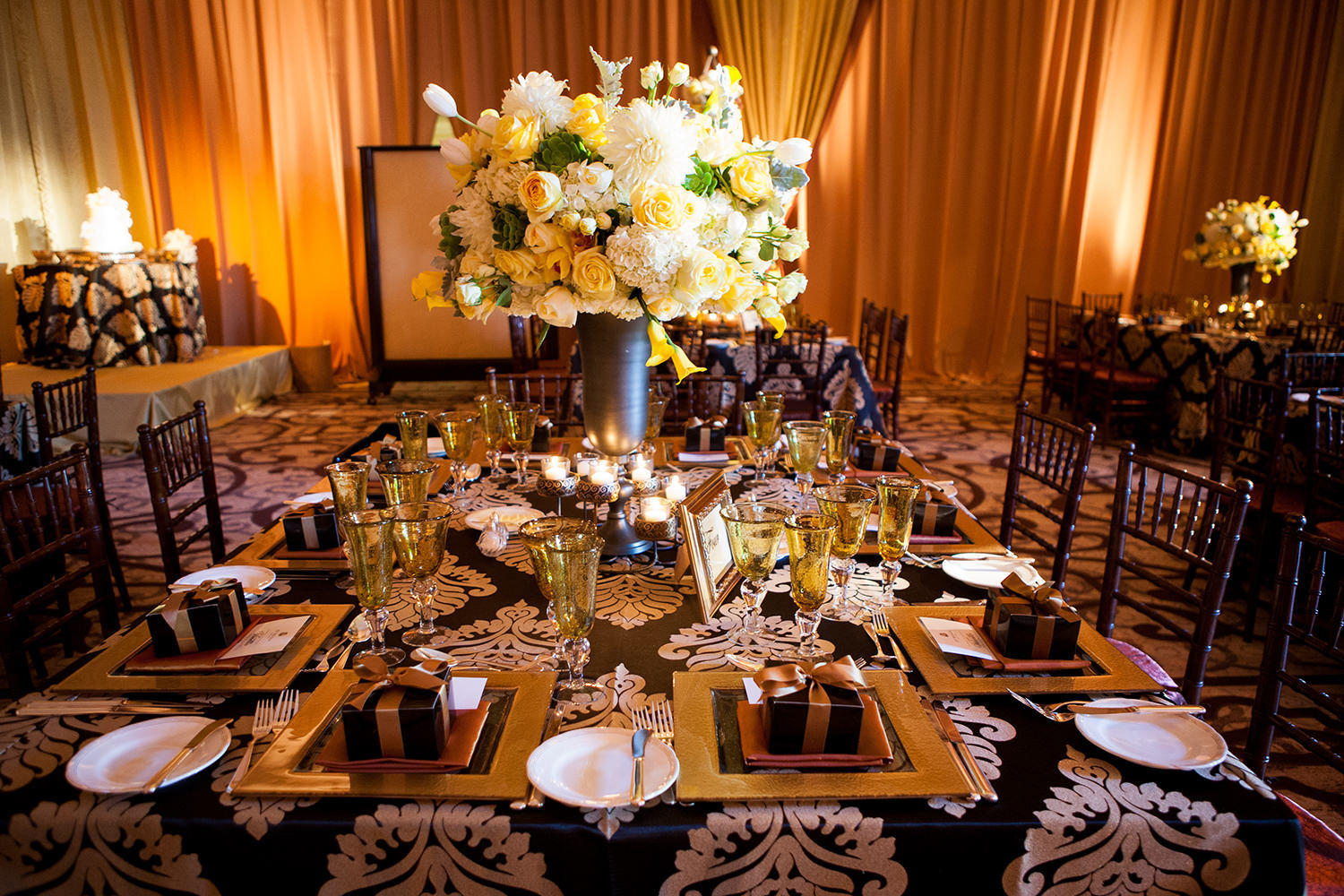 Ornate and richly colored table settings at a wedding reception