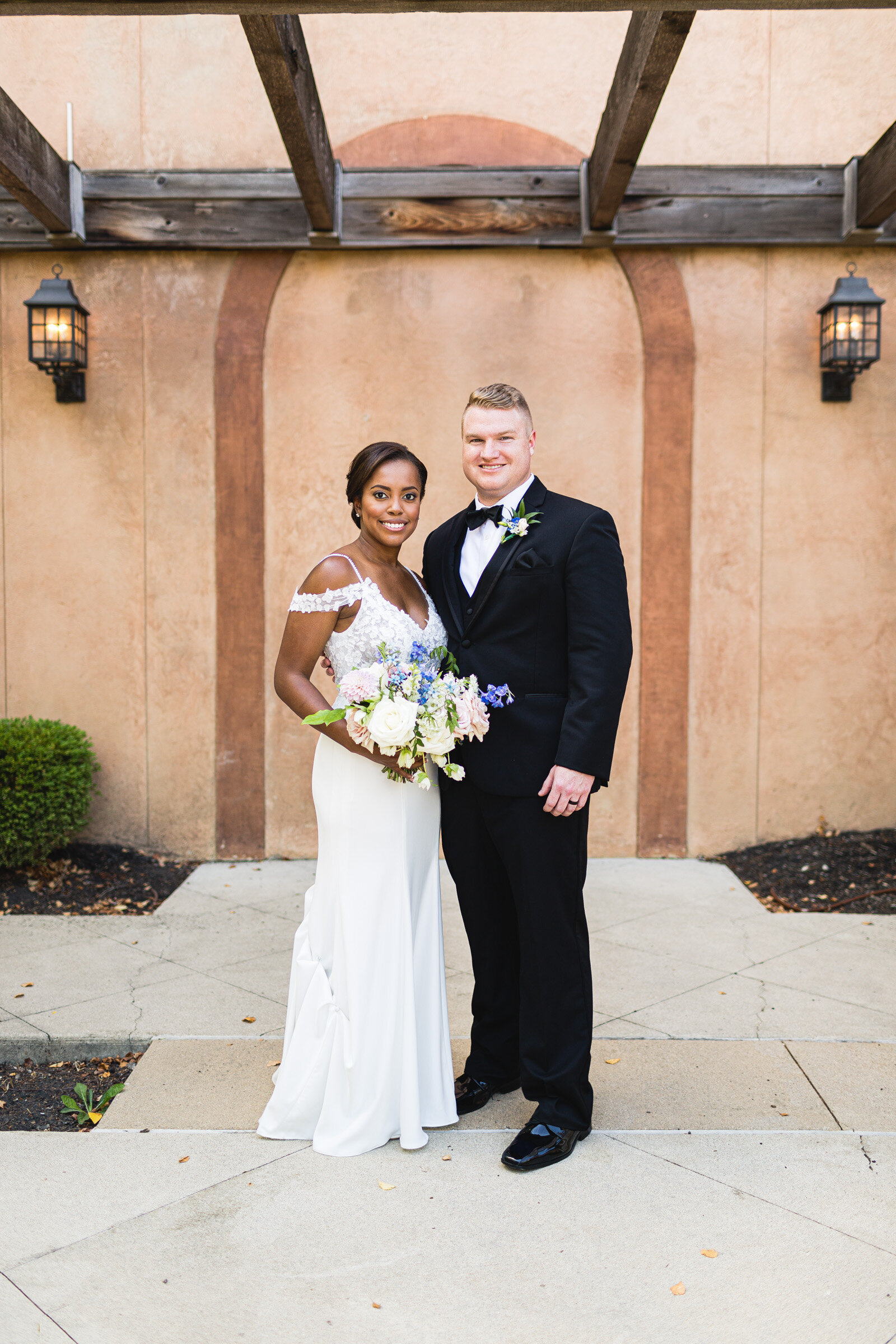 multi racial couple at club at corazon posing for wedding