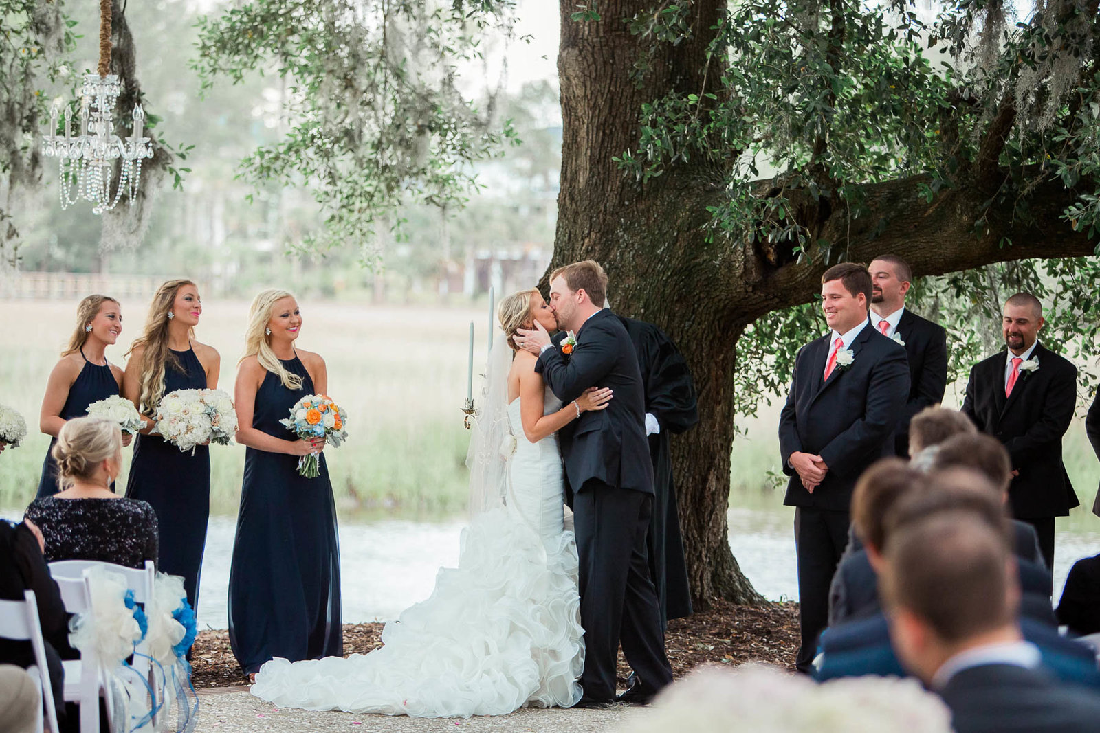 Bride and groom kiss under an oak tree, Dunes West Golf and River Club, Mt Pleasant, South Carolina