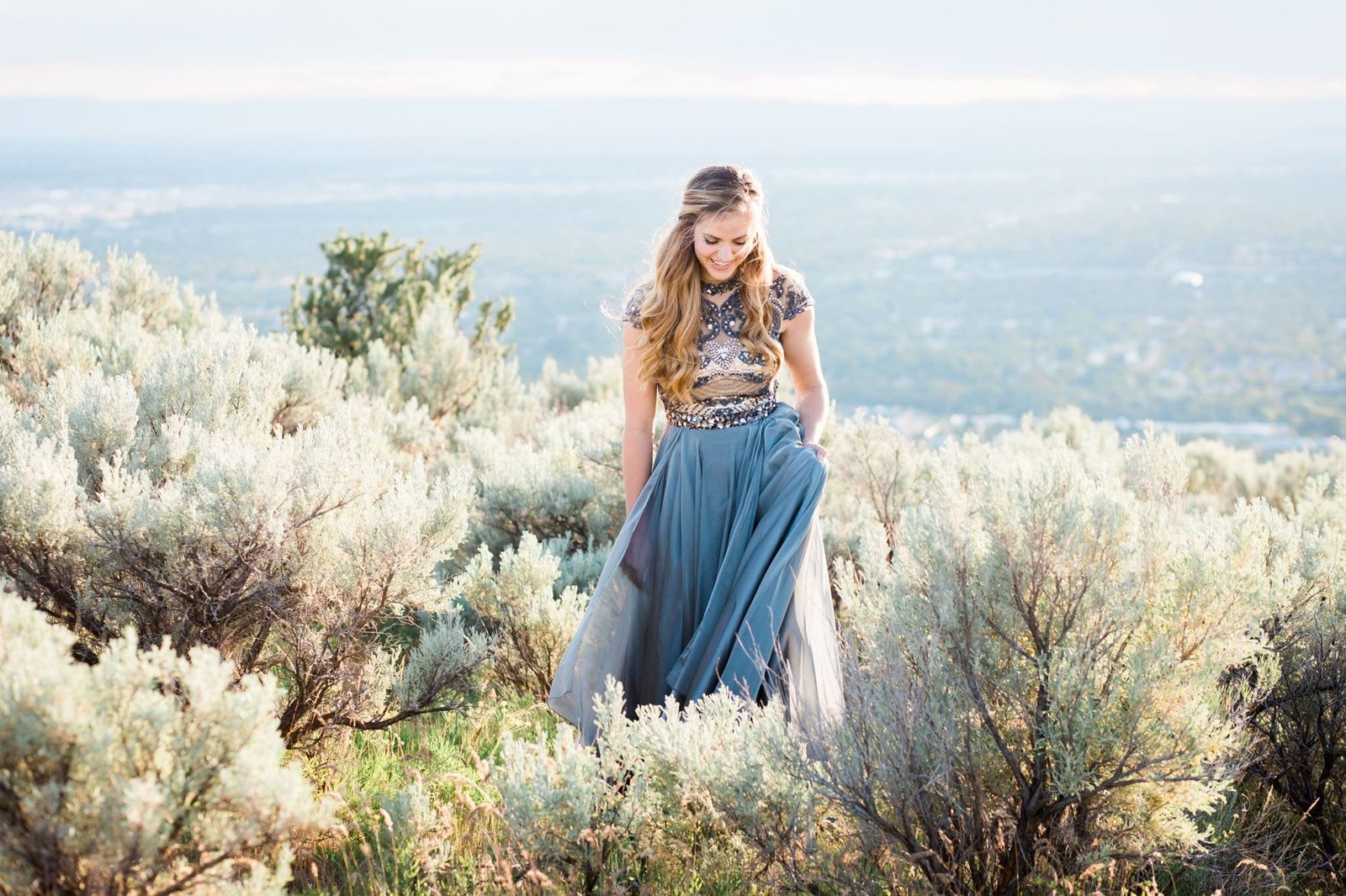 Senior girl wears prom dress for photos