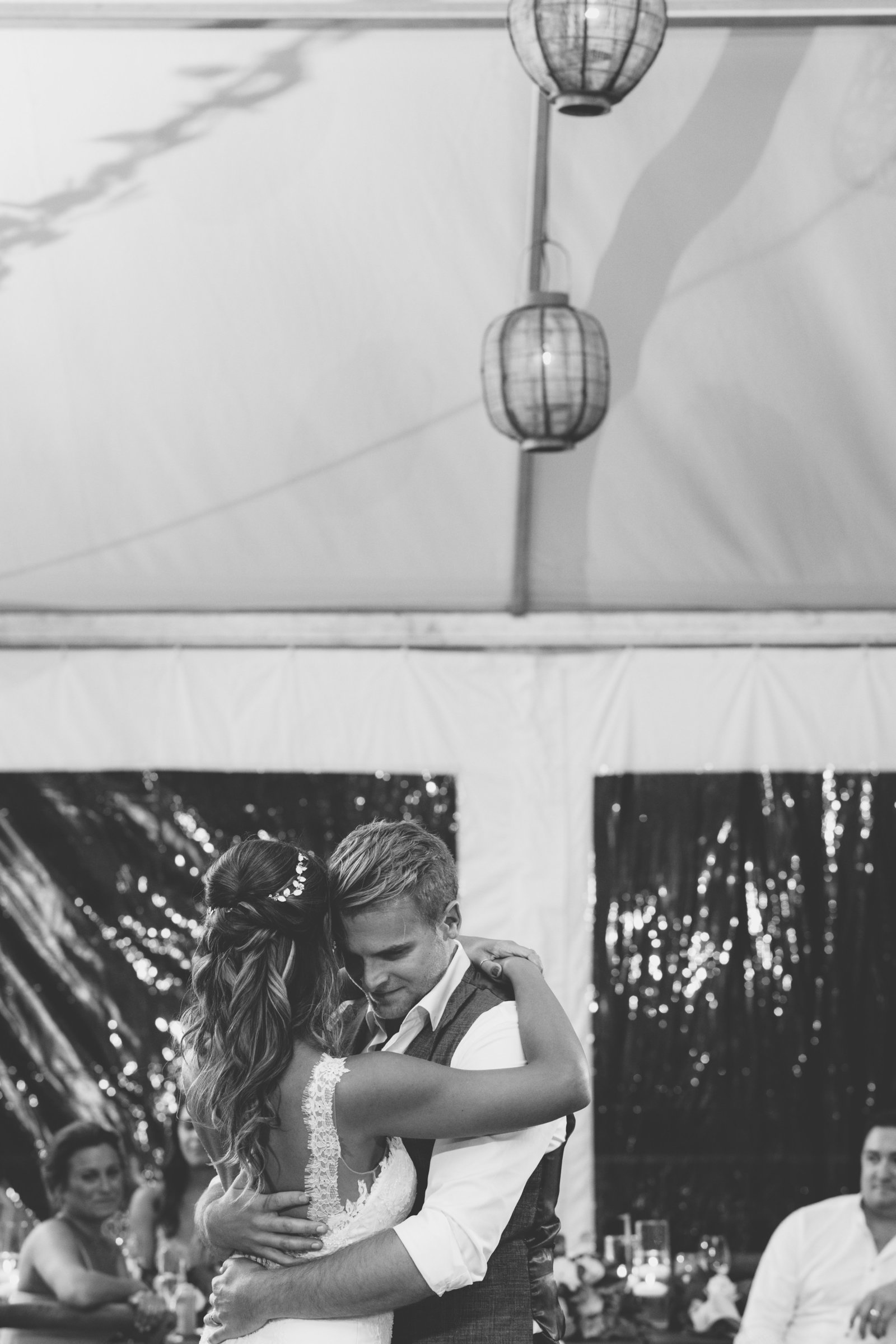 black and white photo of bride groom hugging and dancing Gurneys Montauk Resort wedding