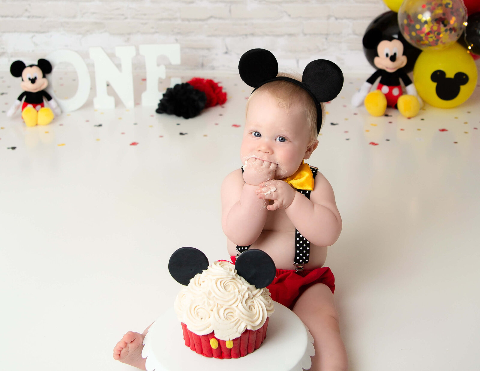 Mickey mouse cake smash at our Rochester, Ny studio.