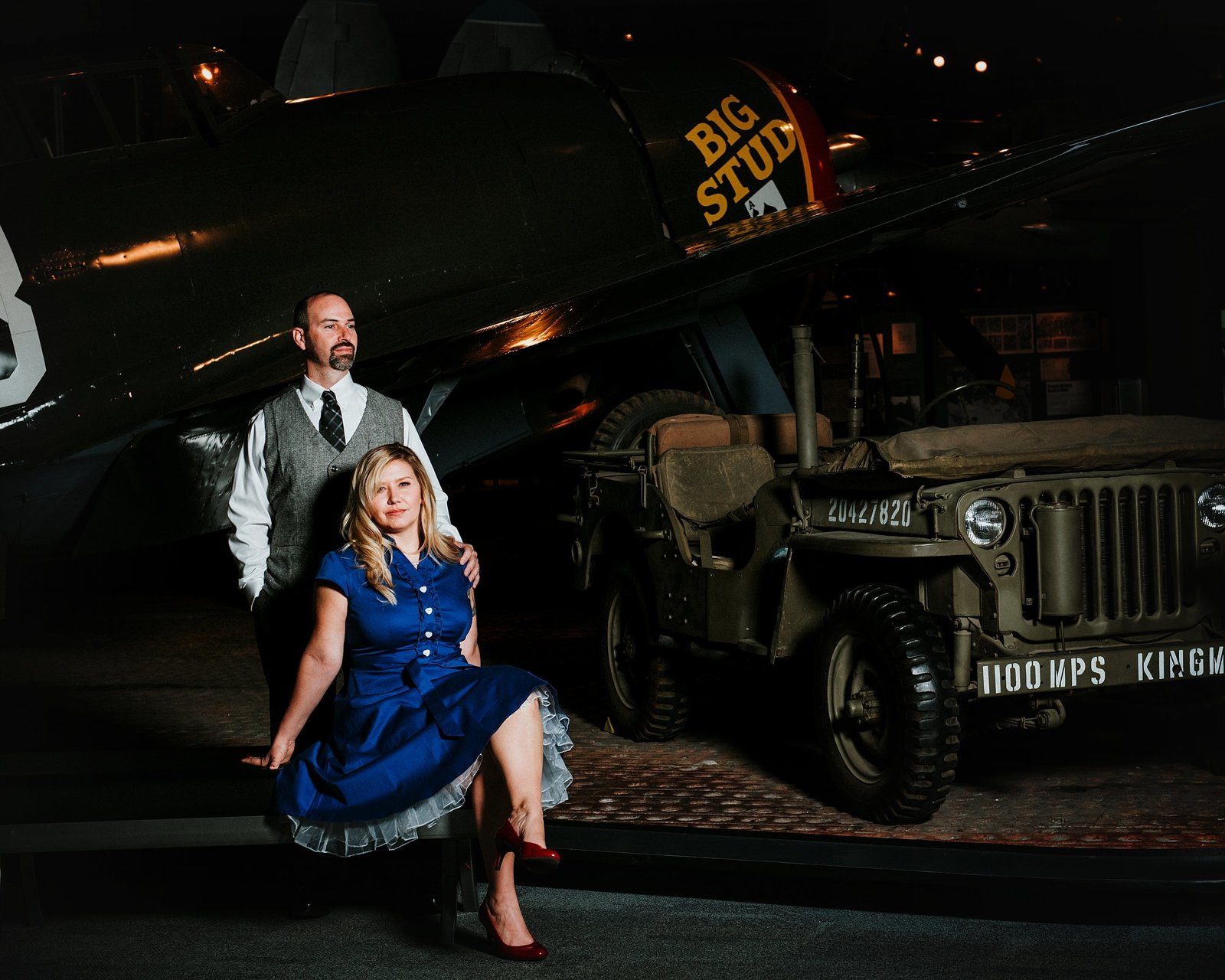 Man and woman infront of vintage war plane by Roslyn Engagement Photographer