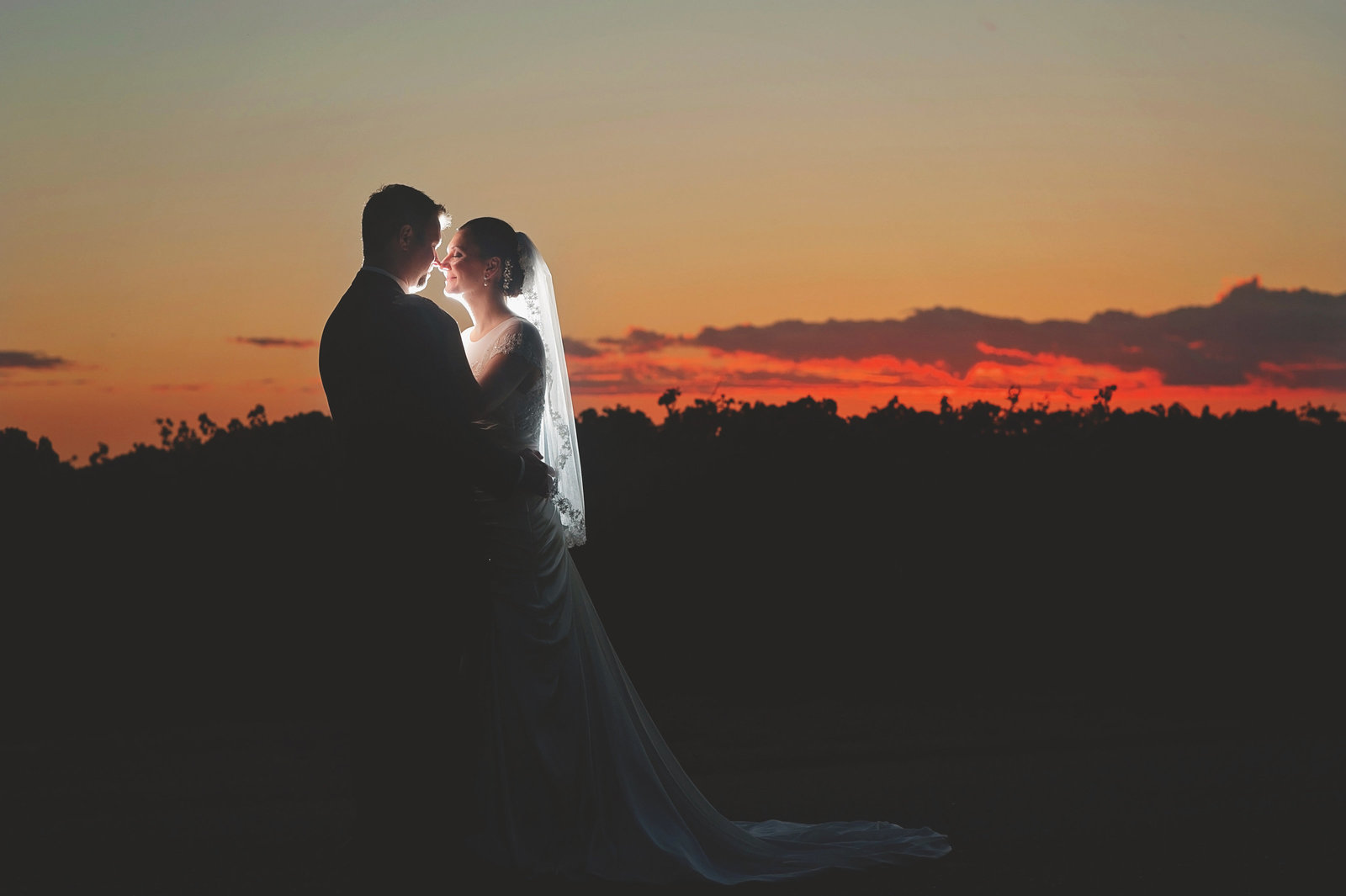 old sugar mill bride and groom  at sunset