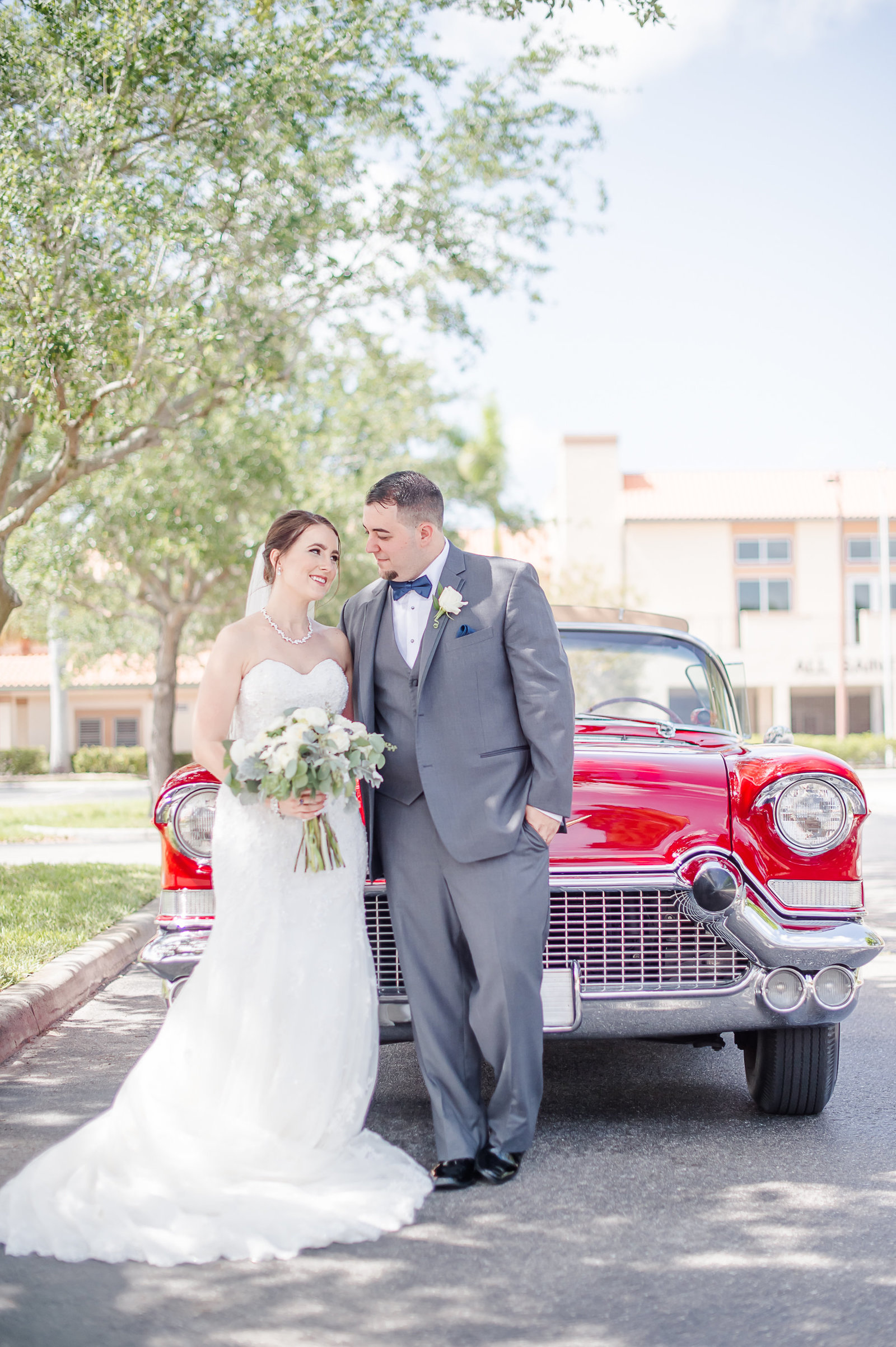 Newlywed in red classic car - Country Club at Mirasol Wedding - Palm Beach Wedding Photography by Palm Beach Photography, Inc.