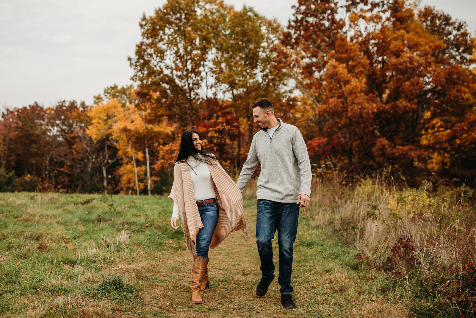 couple gets portraits taken in autumn