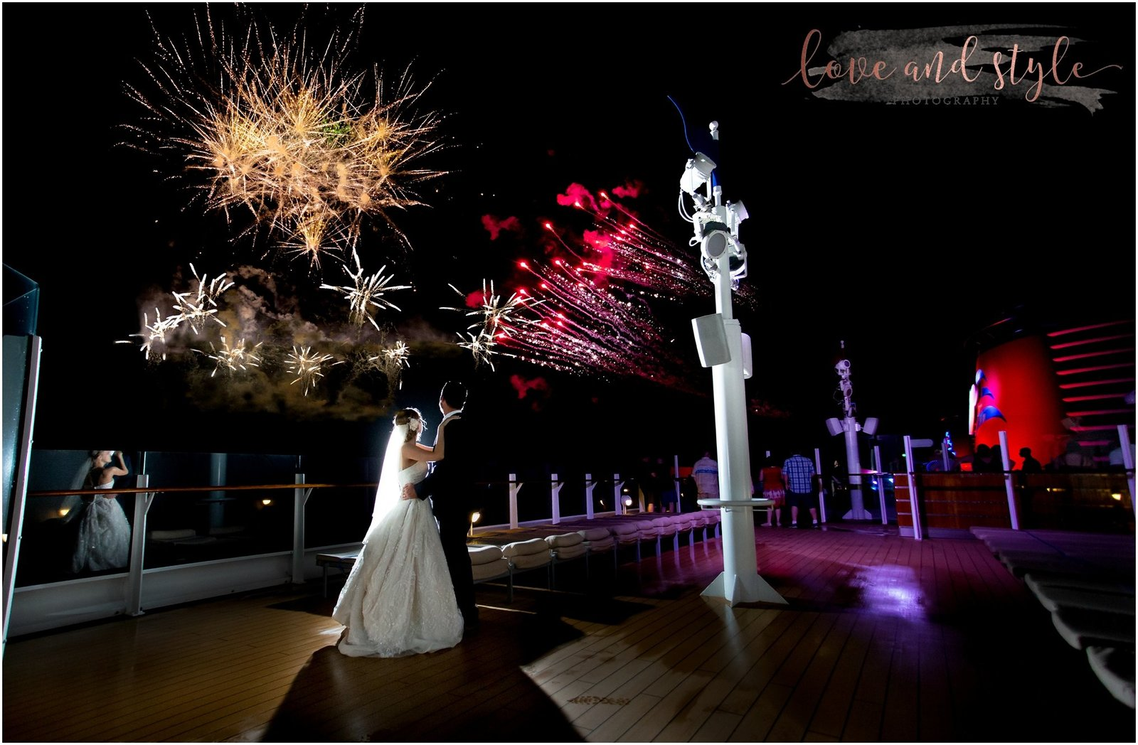 Disney Dream Cruise Wedding Photography bride and groom portrait on the deck with the fireworks in the sky