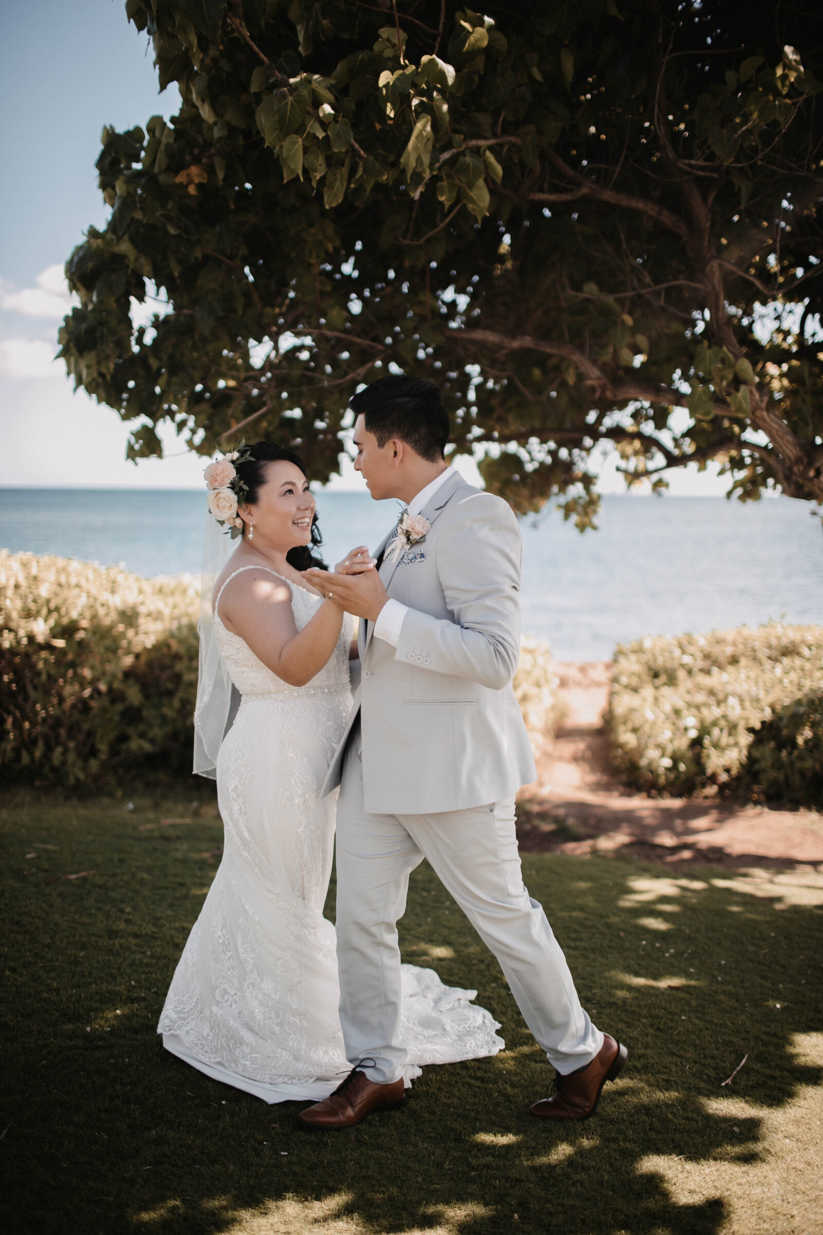 bride-and-groom-dancing-outside-on-the-lawn-near-ocean
