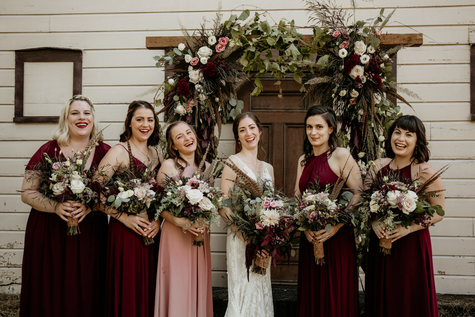 Bride and her bridesmaids laughing.