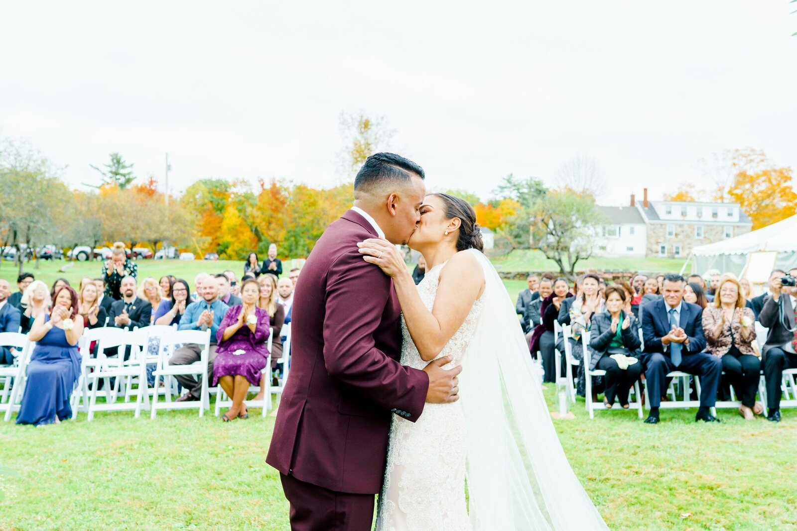 Bride and groom kissing at New Hampshire wedding ceremony