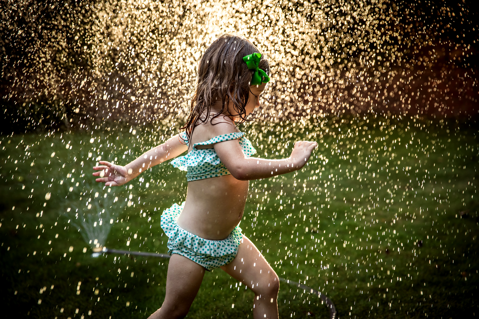 family photographer, columbus, ga, atlanta, documentary, photojournalism, sprinkler, sun, water drops, little girl running, ker-fox photography_8502