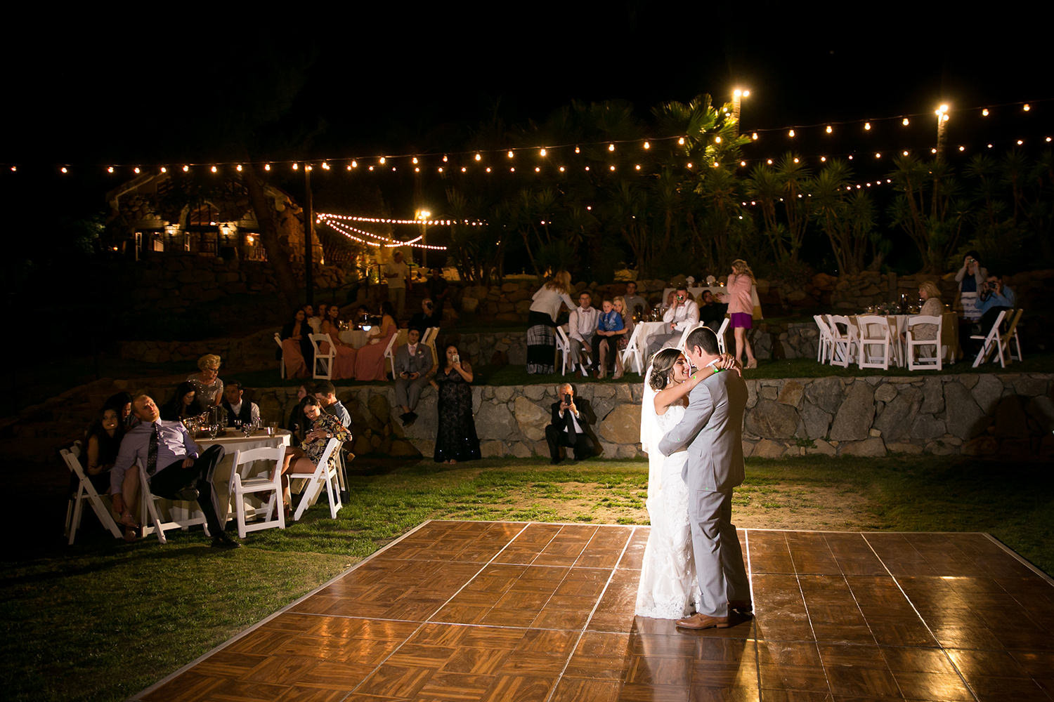 nightime reception image bride and groom dancing