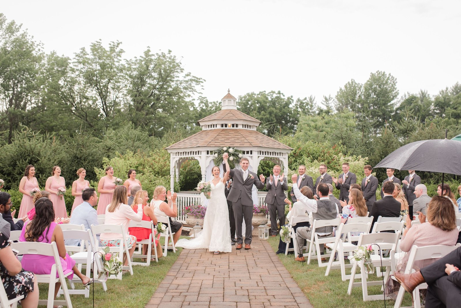 wedding recessional at Farmhouse at the Grand Colonial