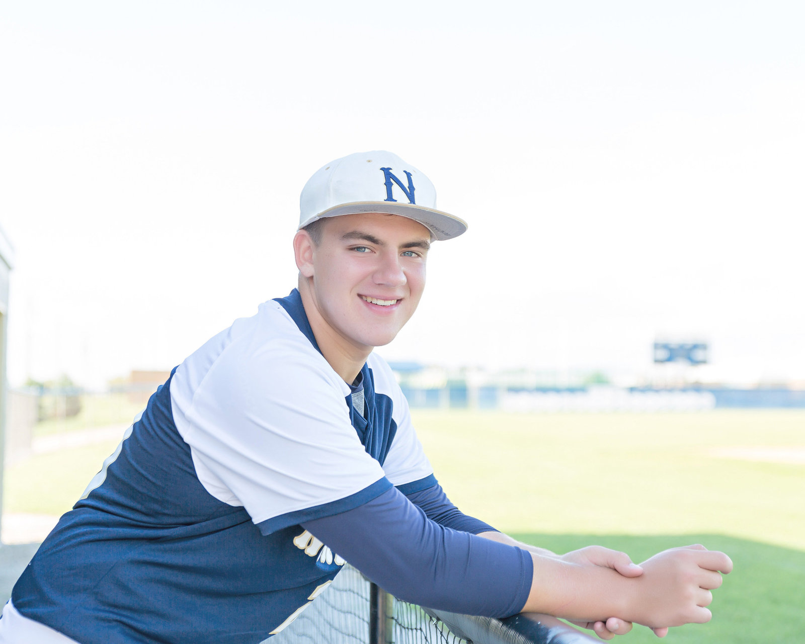 Senior guy-baseball field-baseball uniform-navy and white
