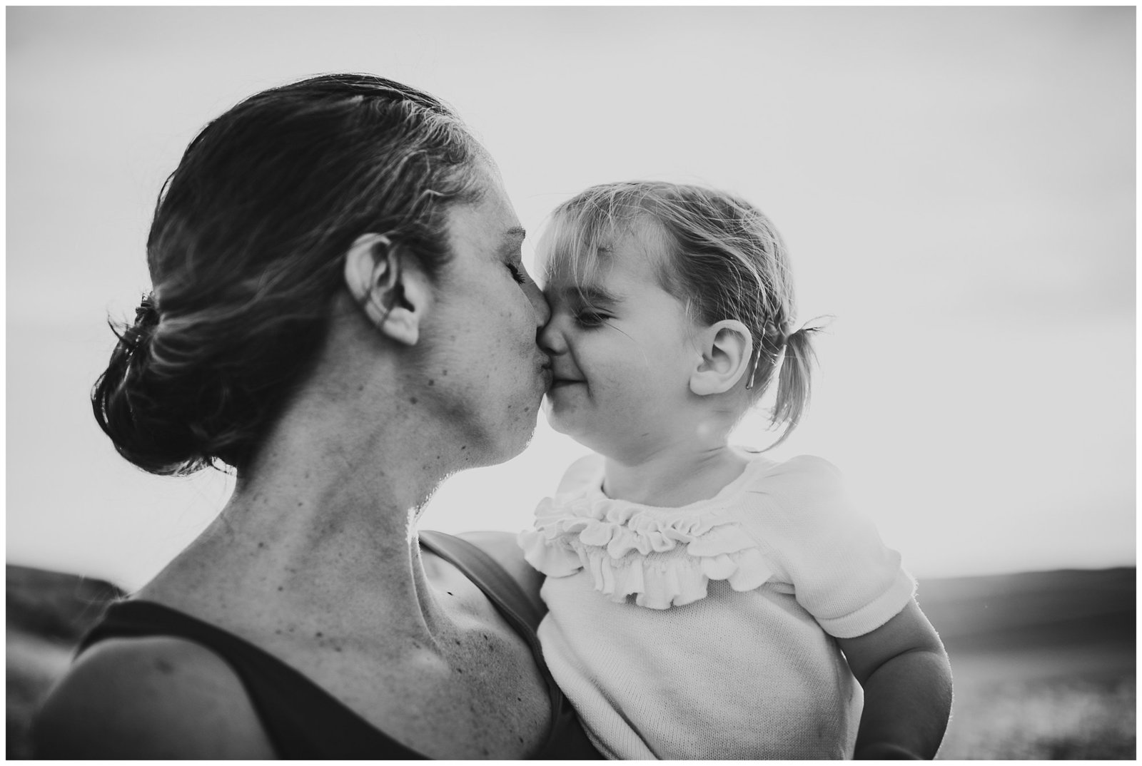 little girl kissing her mom black and white Emily Ann Photography Seattle Family Photographer