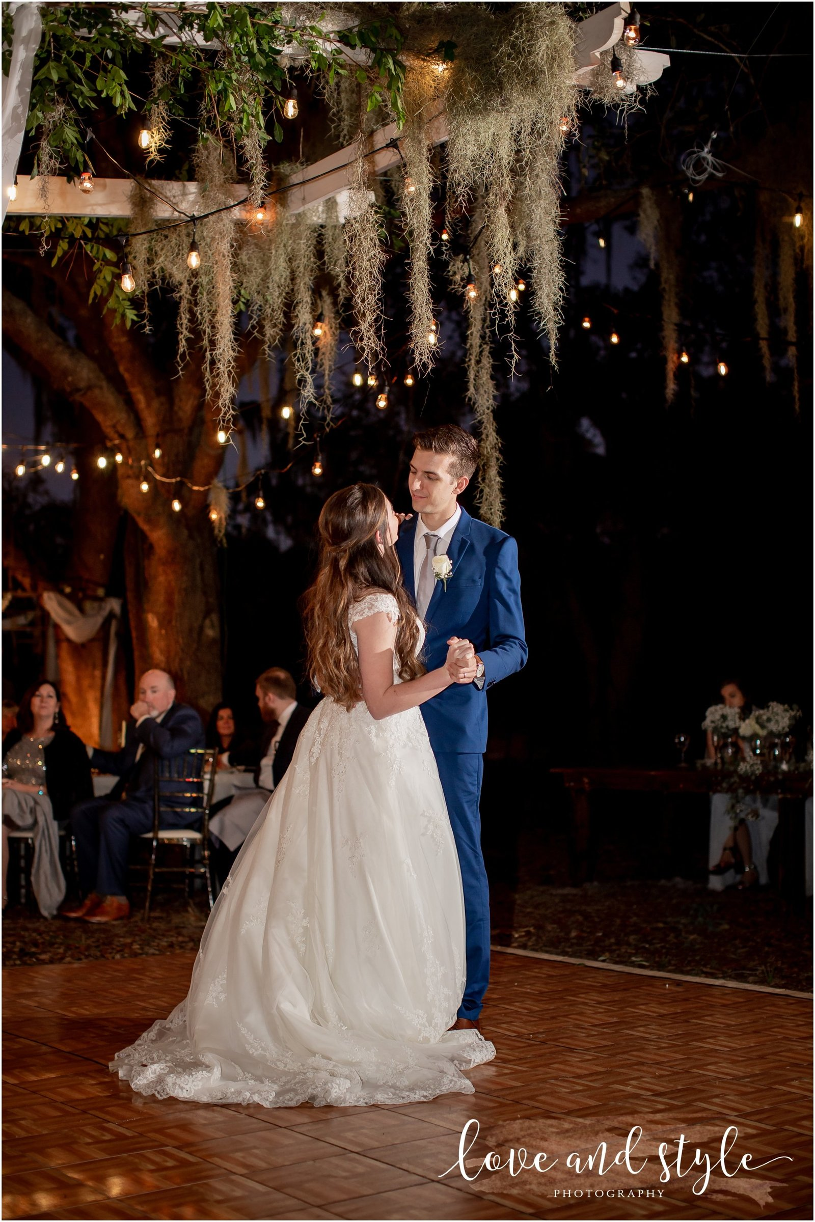 Bride and Groom dancing for the first time as husband and wife  at The Barn at Chapel Creek Wedding venue in Venice, Florida