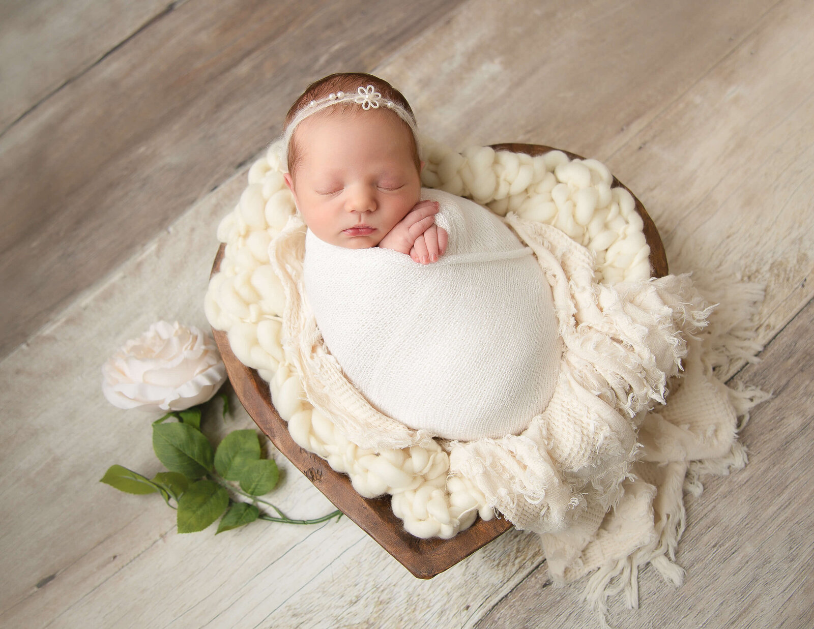 Cute newborn girl posed at our in-home Rochester, NY studio.