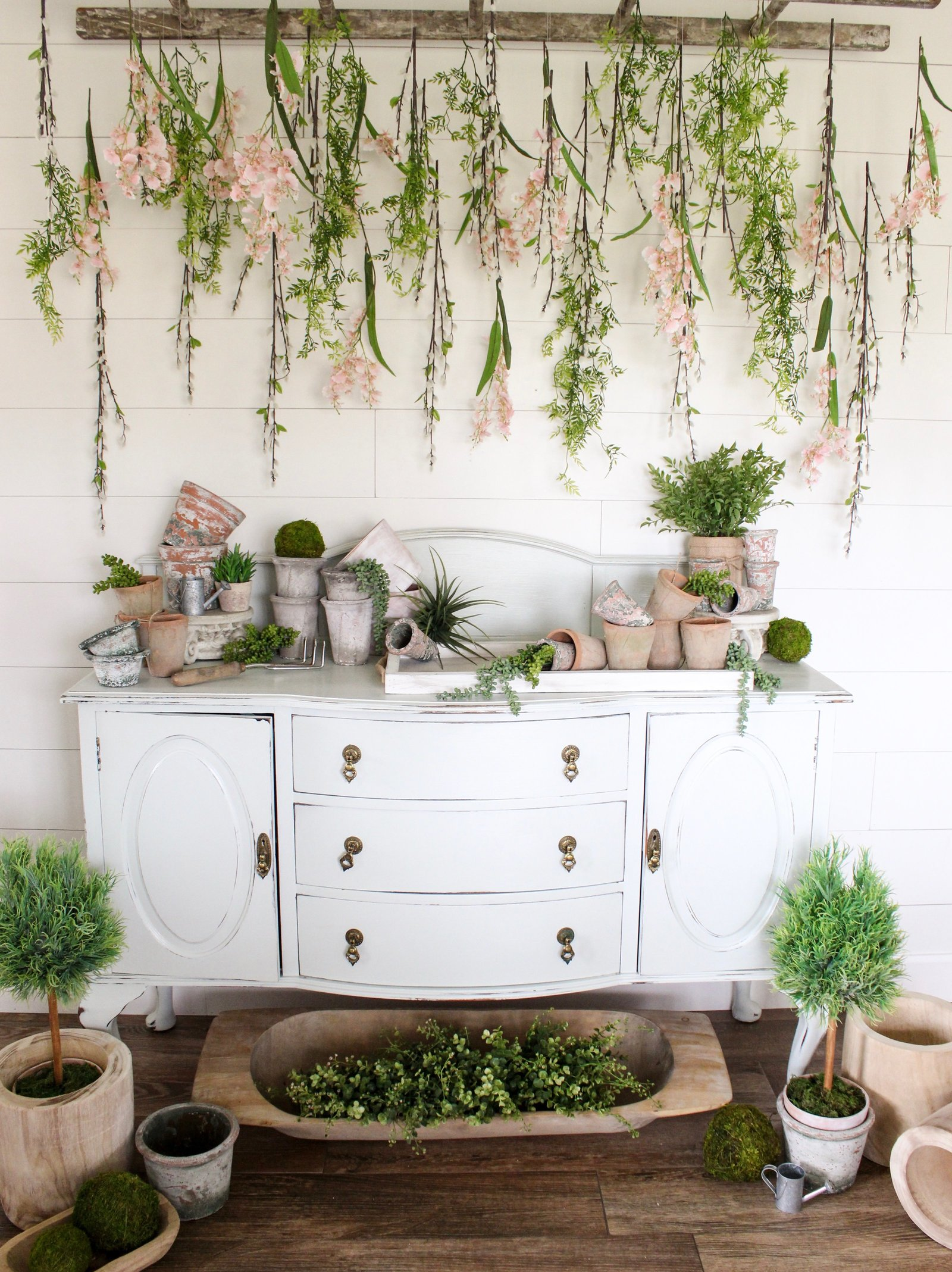 CottonStem.com farmhouse spring decor hanging flowers potting table