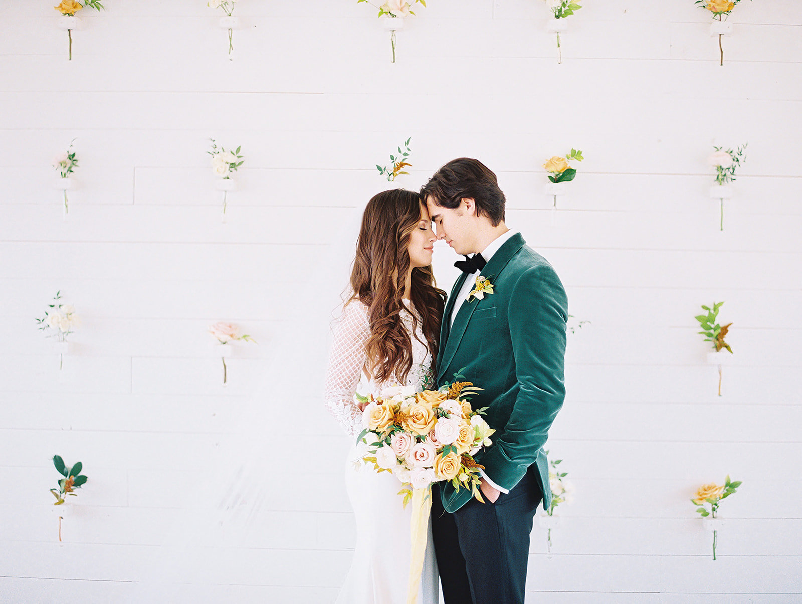 bride-and-groom-in-front-of-Prospect-House-flower-wall