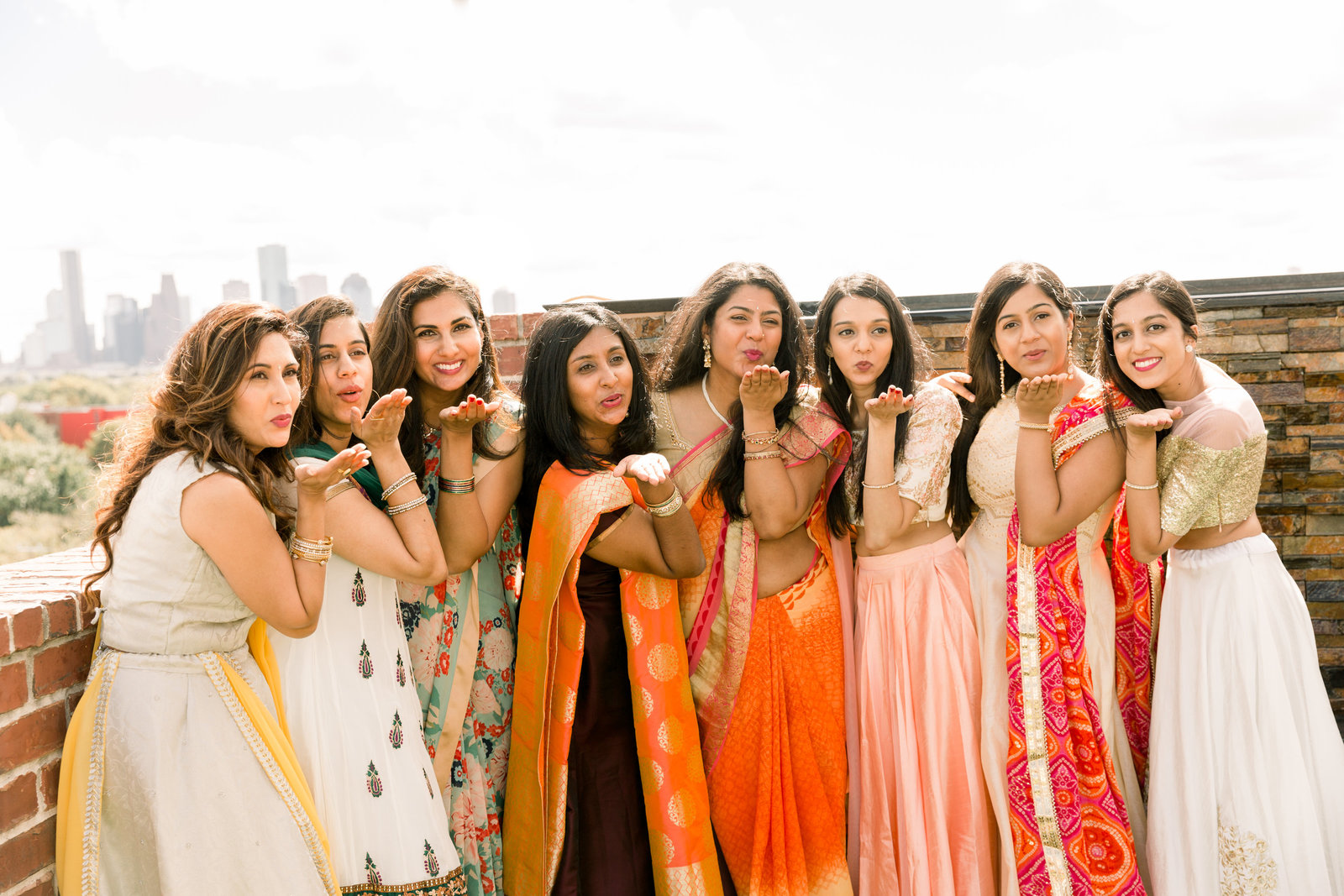 girls in the family smile and blow a kiss at a Hindu baby shower