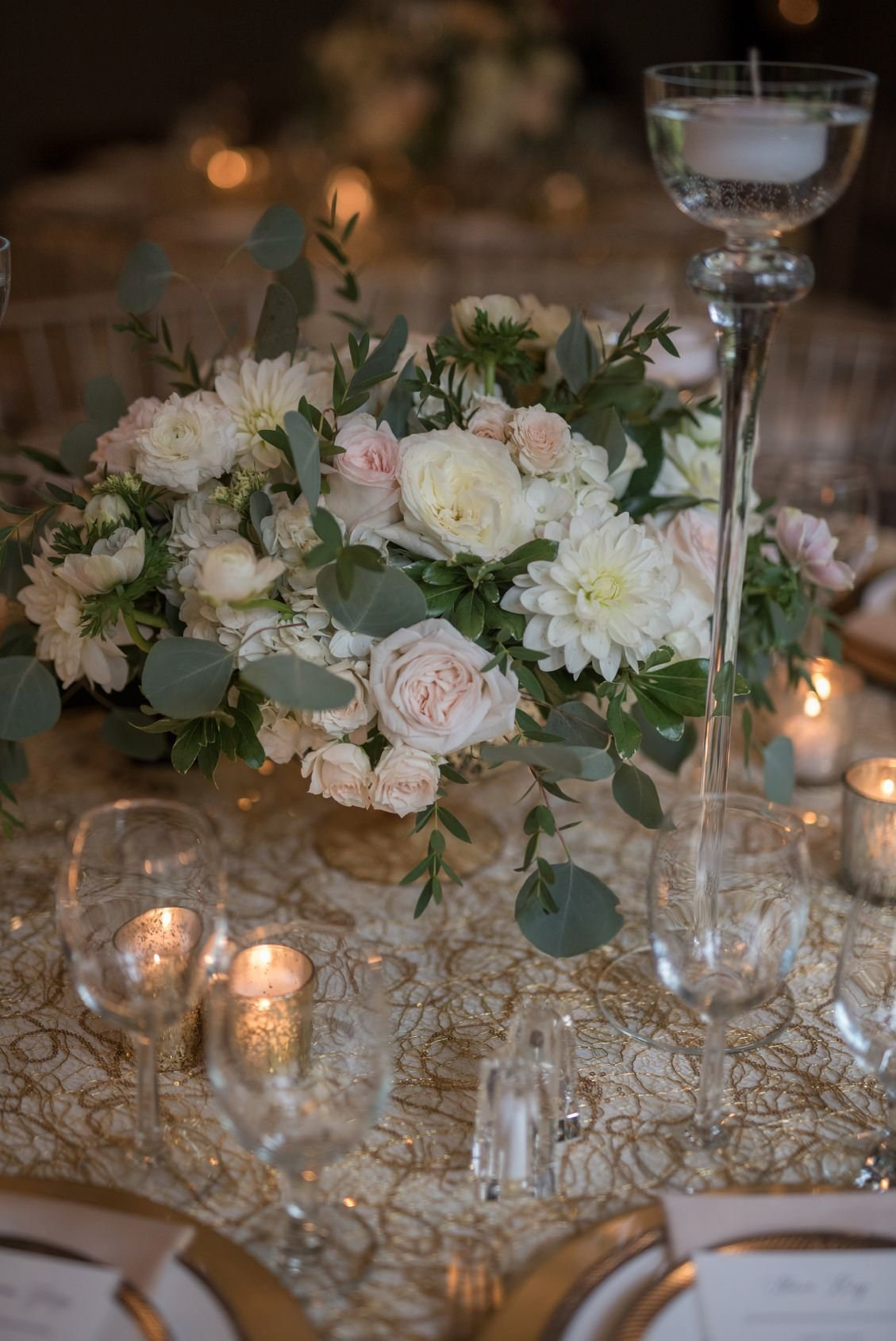 Classic wedding tablescape and placesetting in gold, champagne, silver, white and blush at Lord Thompson Manor, CT