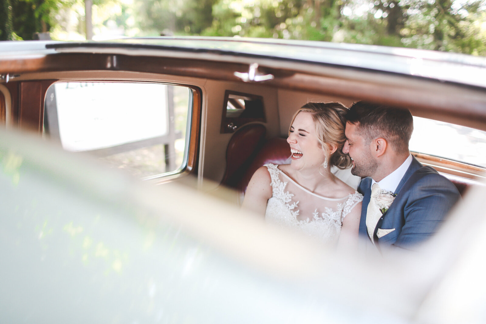 WP-SURREY-WEDDING-FUN-BRIDE-GROOM-LAUGHING-CAR-NATURAL_0004