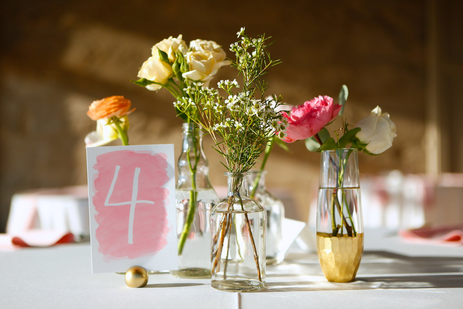 colorful bud vase centerpieces with watercolor table number