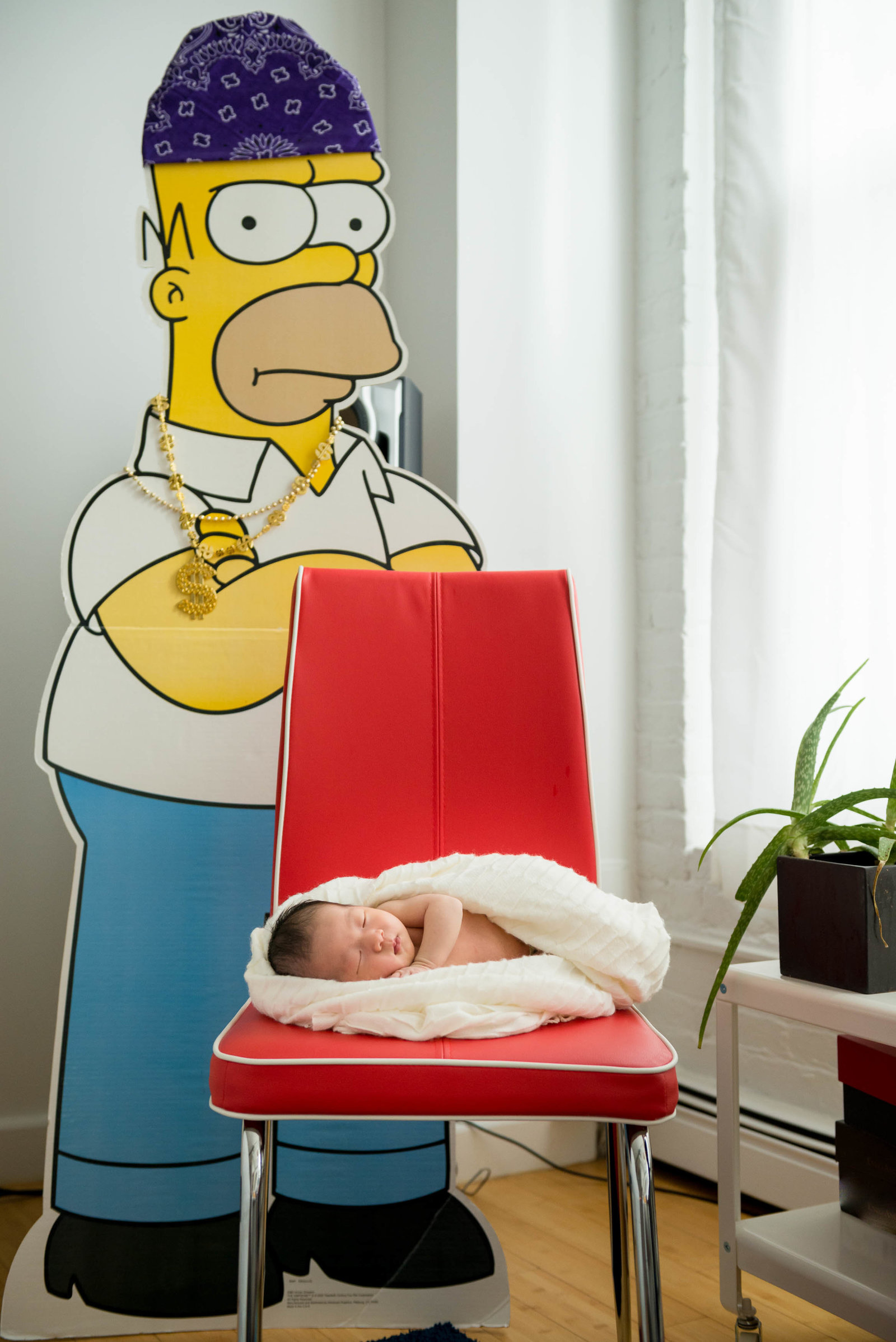Newborn posed at home on furniture in lifestyle session Boston