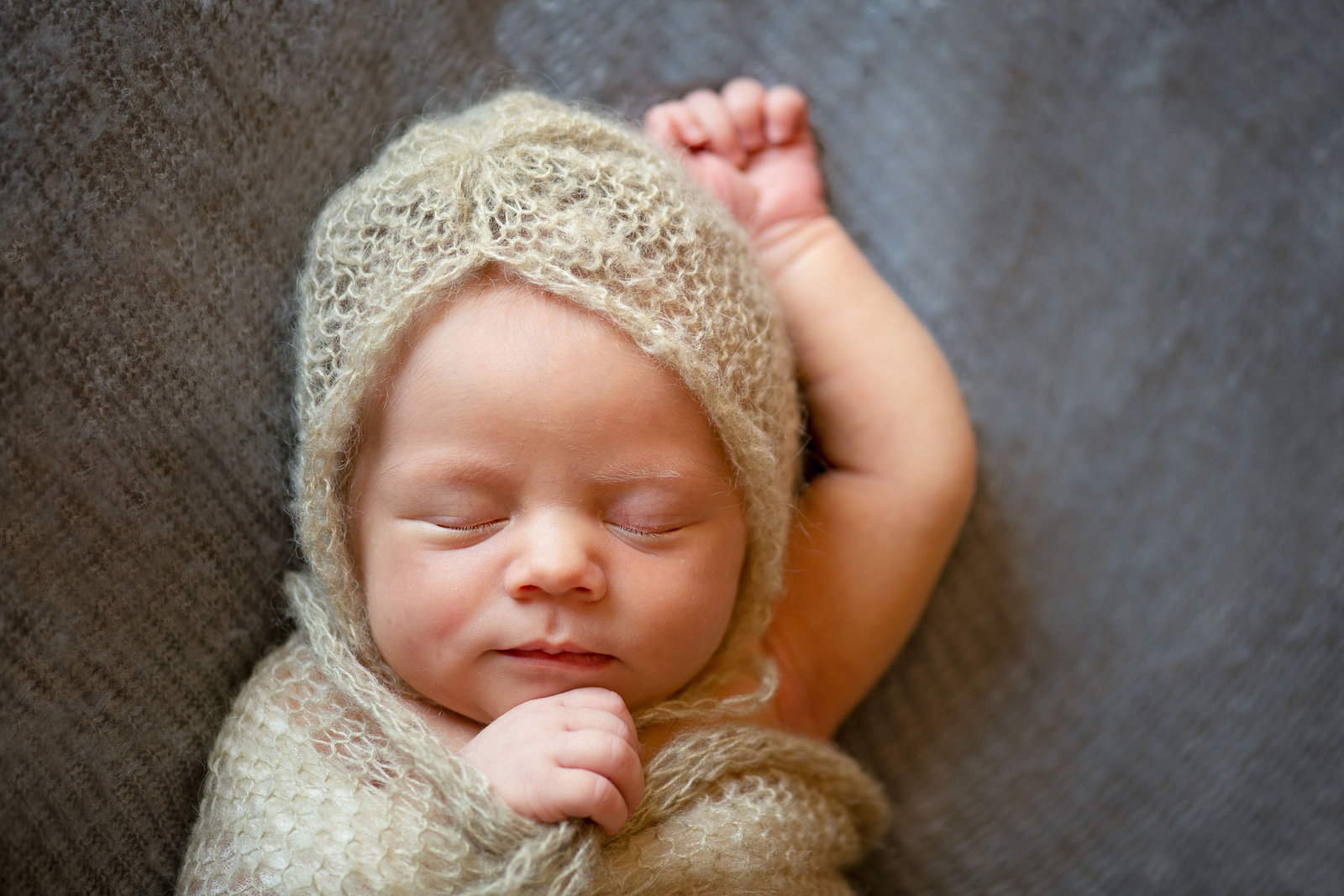 Sleeping baby wrapped in wrap and bonnet. Newborn photographer Madison WI McKenna Patterson Photographer