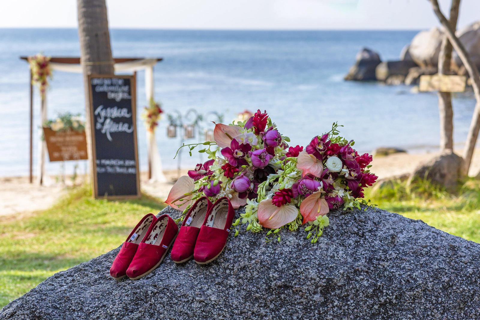 Toms shoes and flowers on a rock