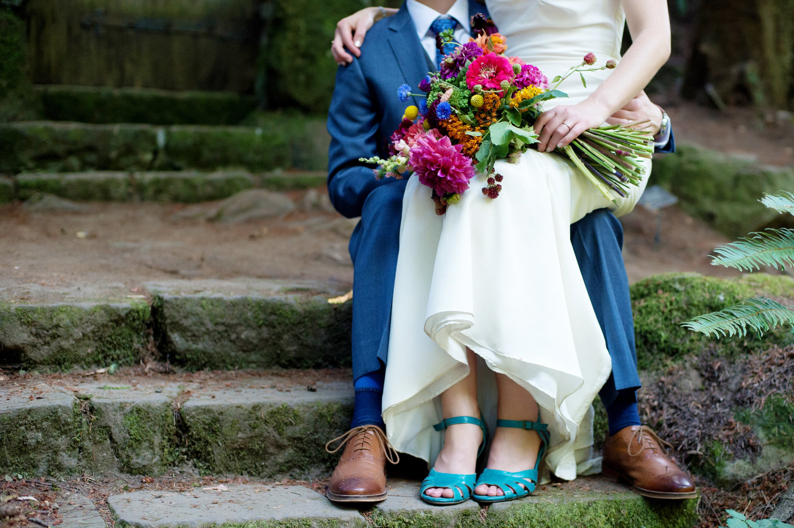 bride wears pretty turquoise shoes and wildflowers