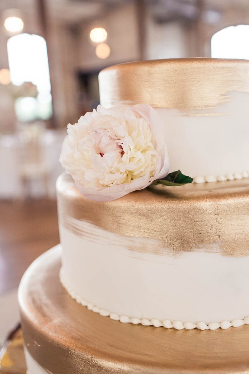 Cake has painted gold on each layer, The Cedar Room, Charleston, South Carolina